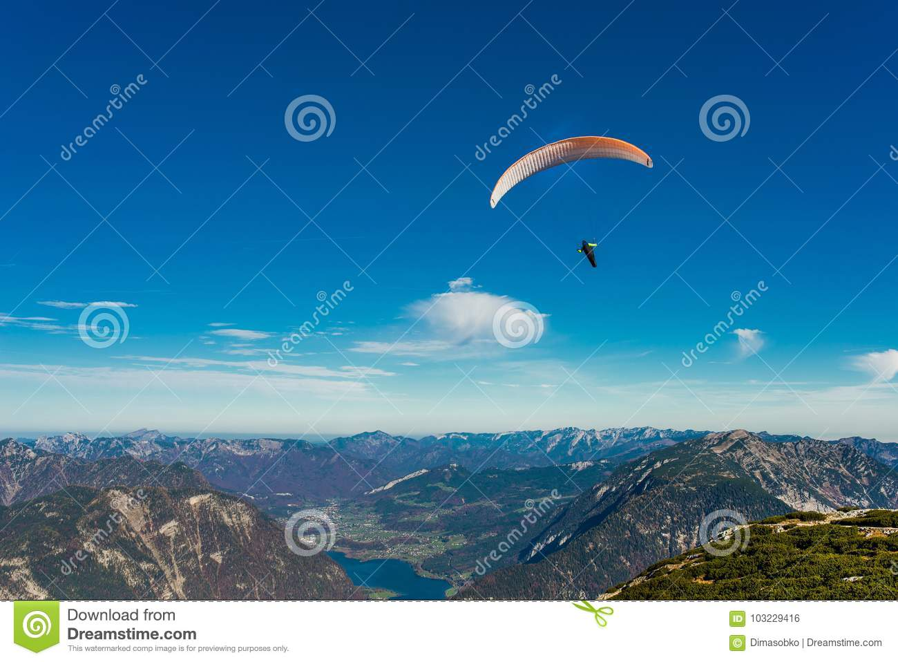 Paraglider Flying In Blue Sky Stock Photo - Image of cloud ...