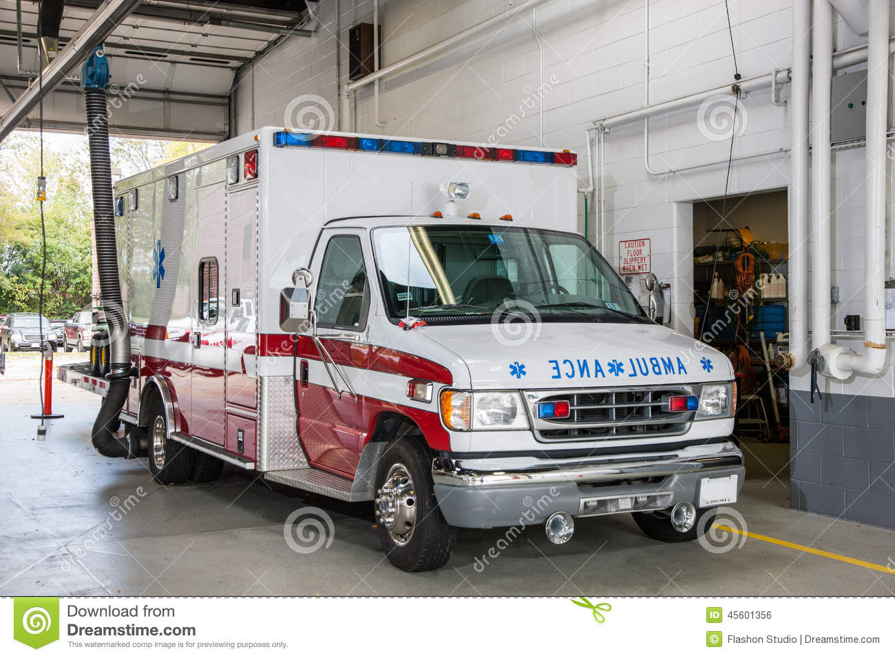 Paramedic Ambulance Inside Firefighter Station Stock Photo ...