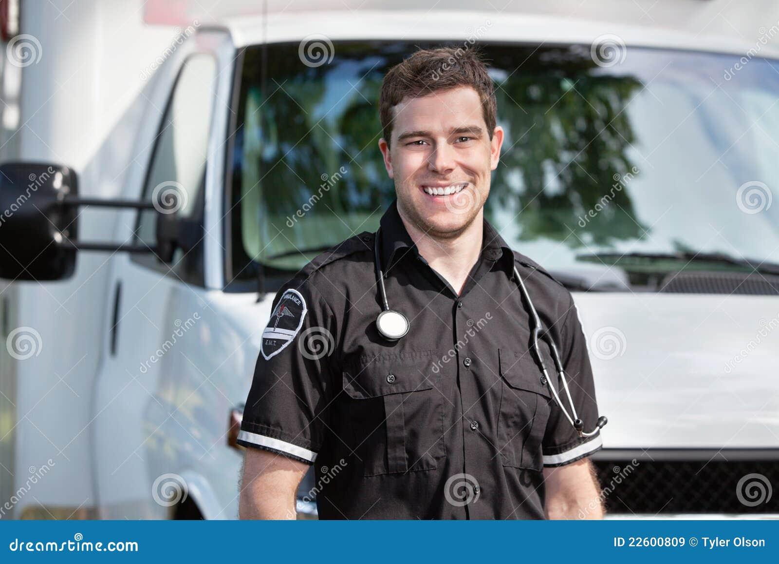Paramedic Man Standing near Ambulance