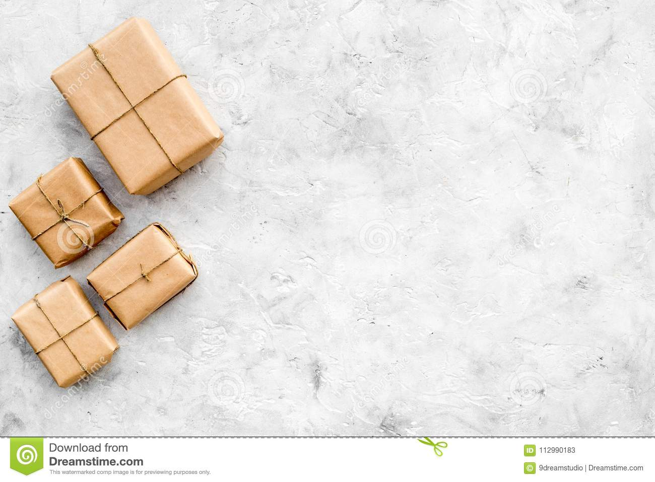 Parcels box in delivery service office stone background top view space for text