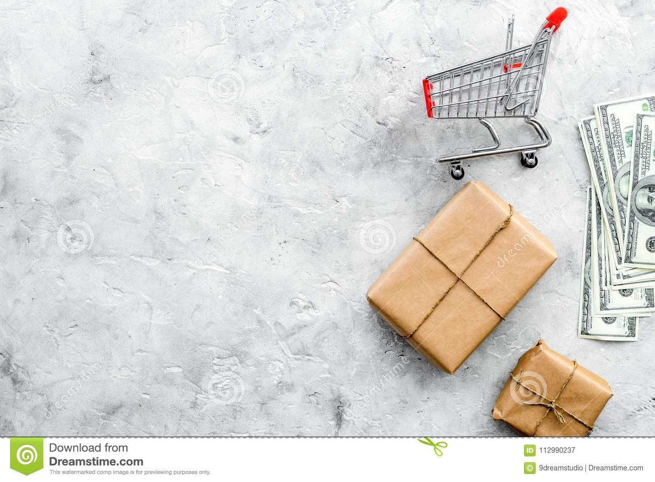 Parcels box and trolley in delivery service office stone background top view space for text