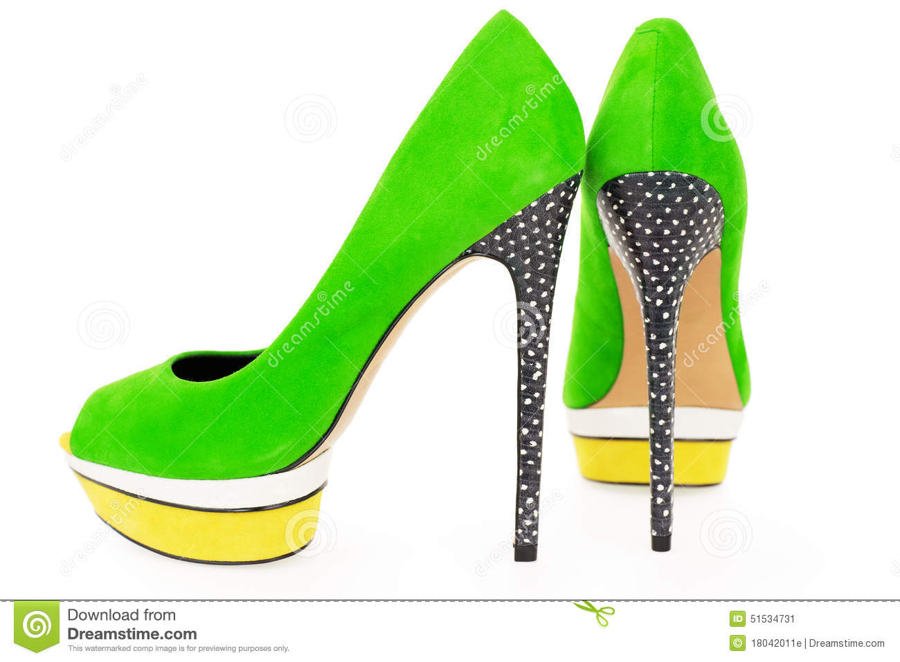 pare of bright green and yellow high heel shoes on whit