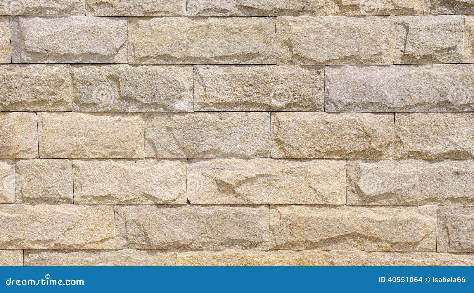 Pared alineada con las losas de la piedra caliza foto de for Losas de pared