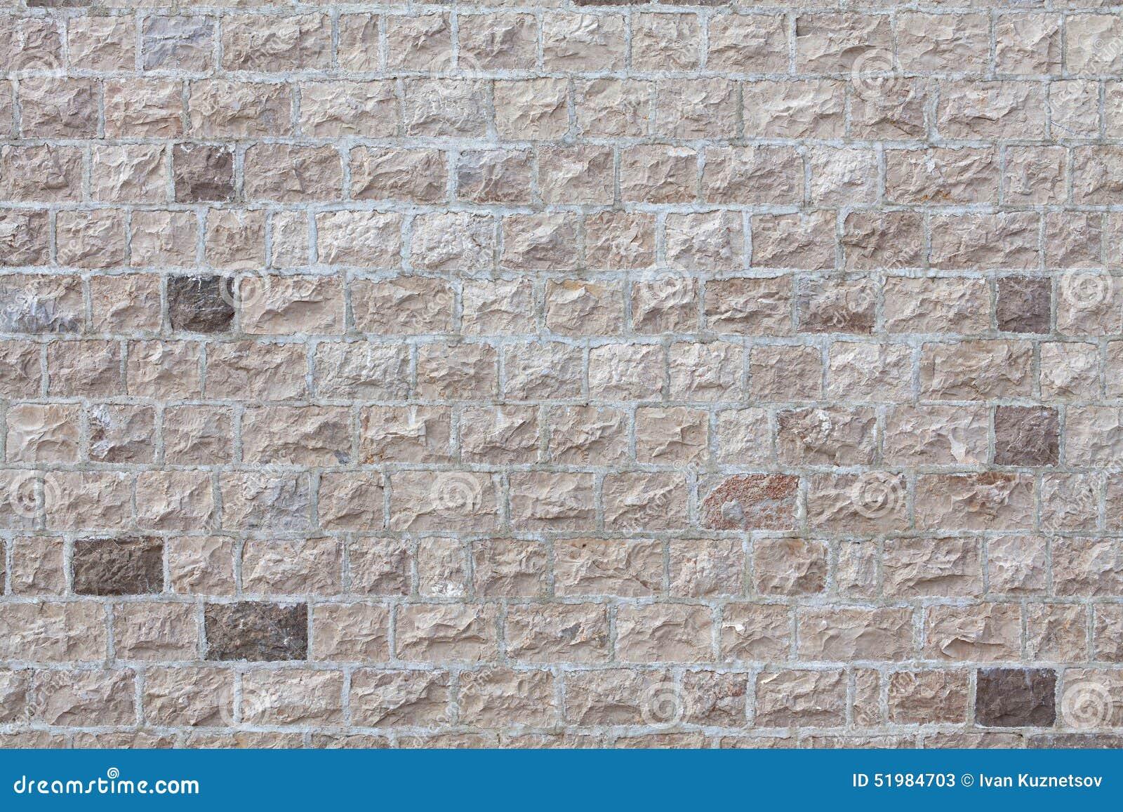 Pared de la casa hecha frente con las tejas de piedra foto - Pared interior de piedra ...