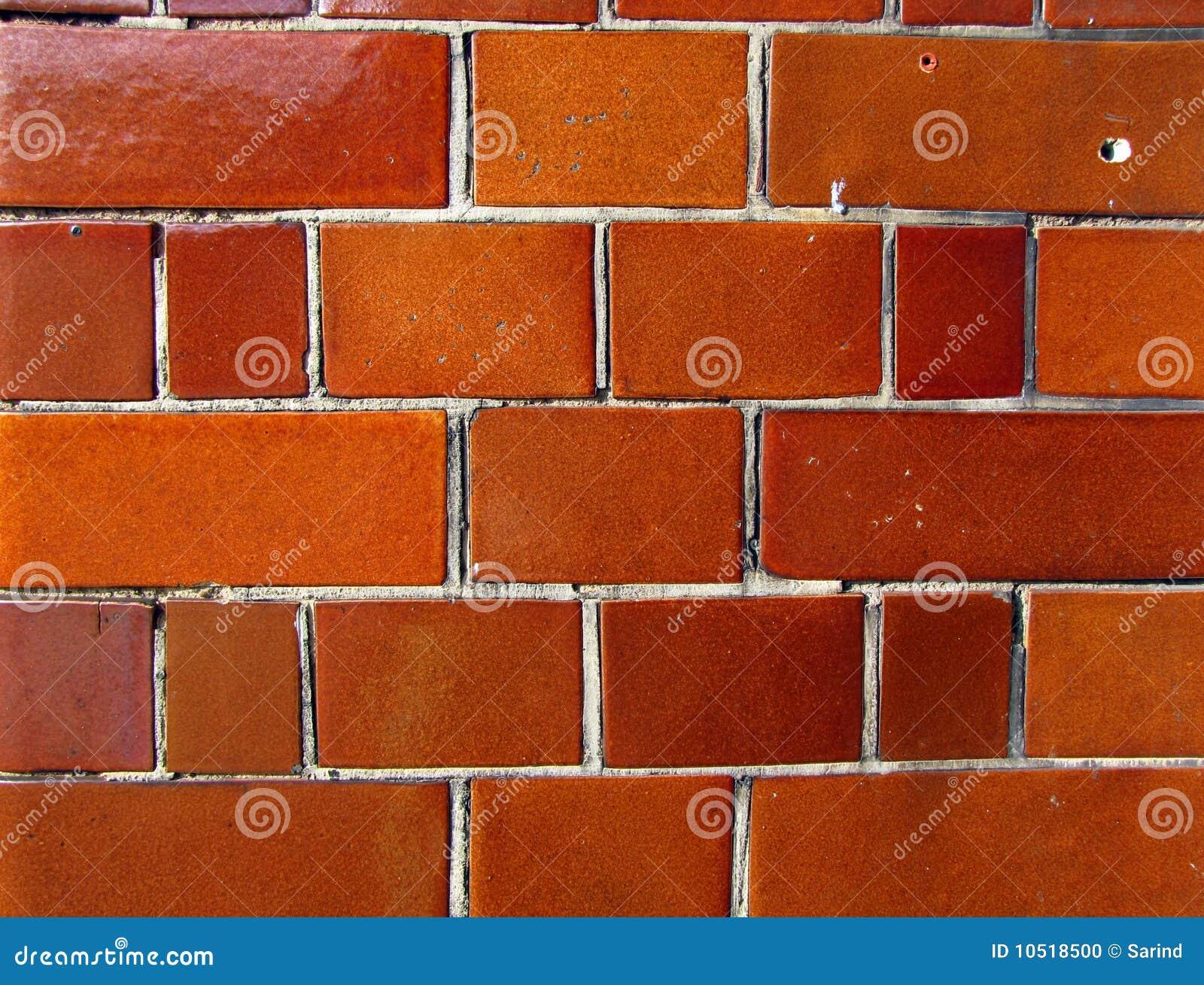 Pared de ladrillo anaranjada brillante foto de archivo for Casas de ladrillo visto fotos