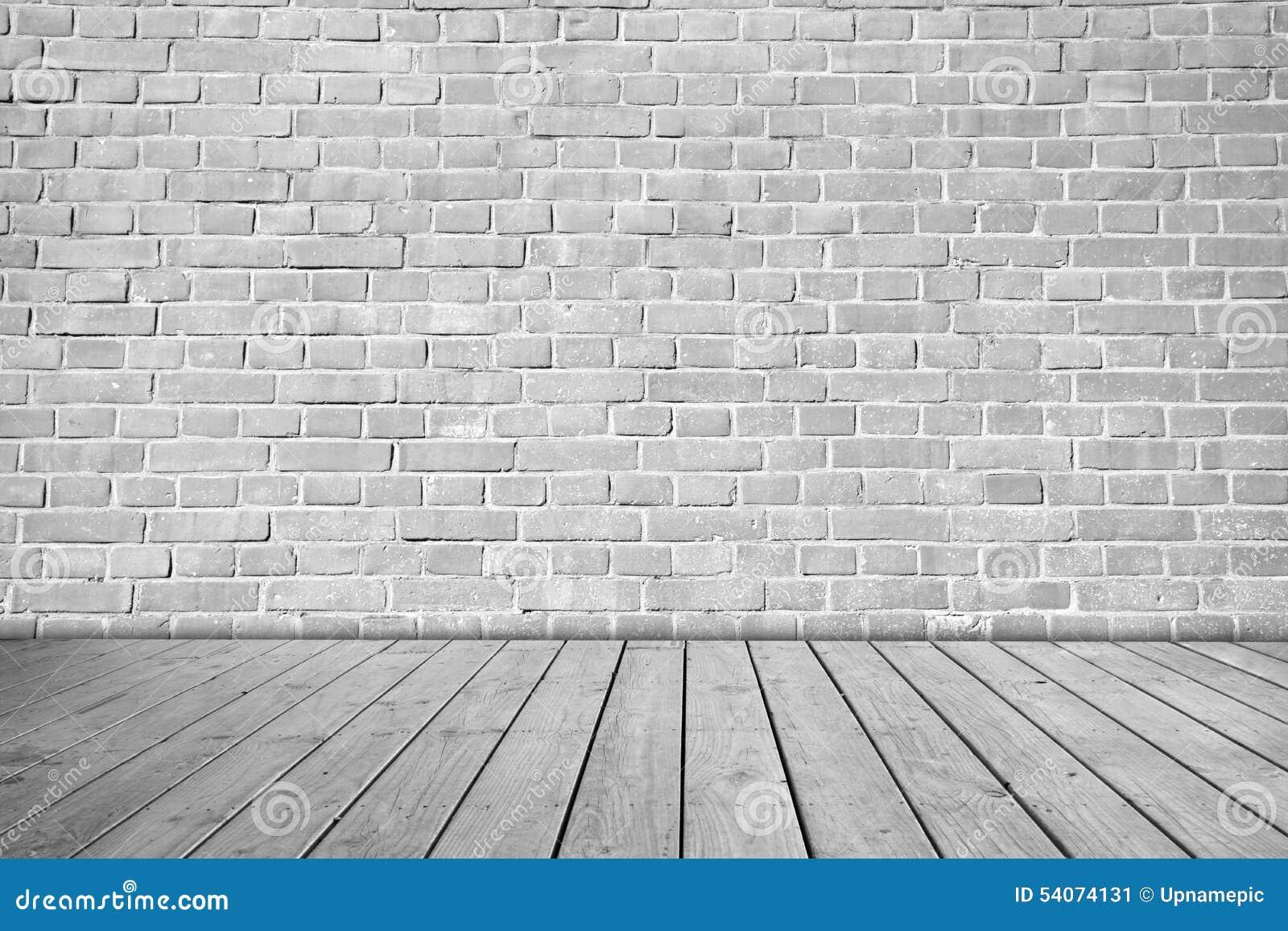 Pared de ladrillo gris en piso de madera foto de archivo - Piso madera gris ...