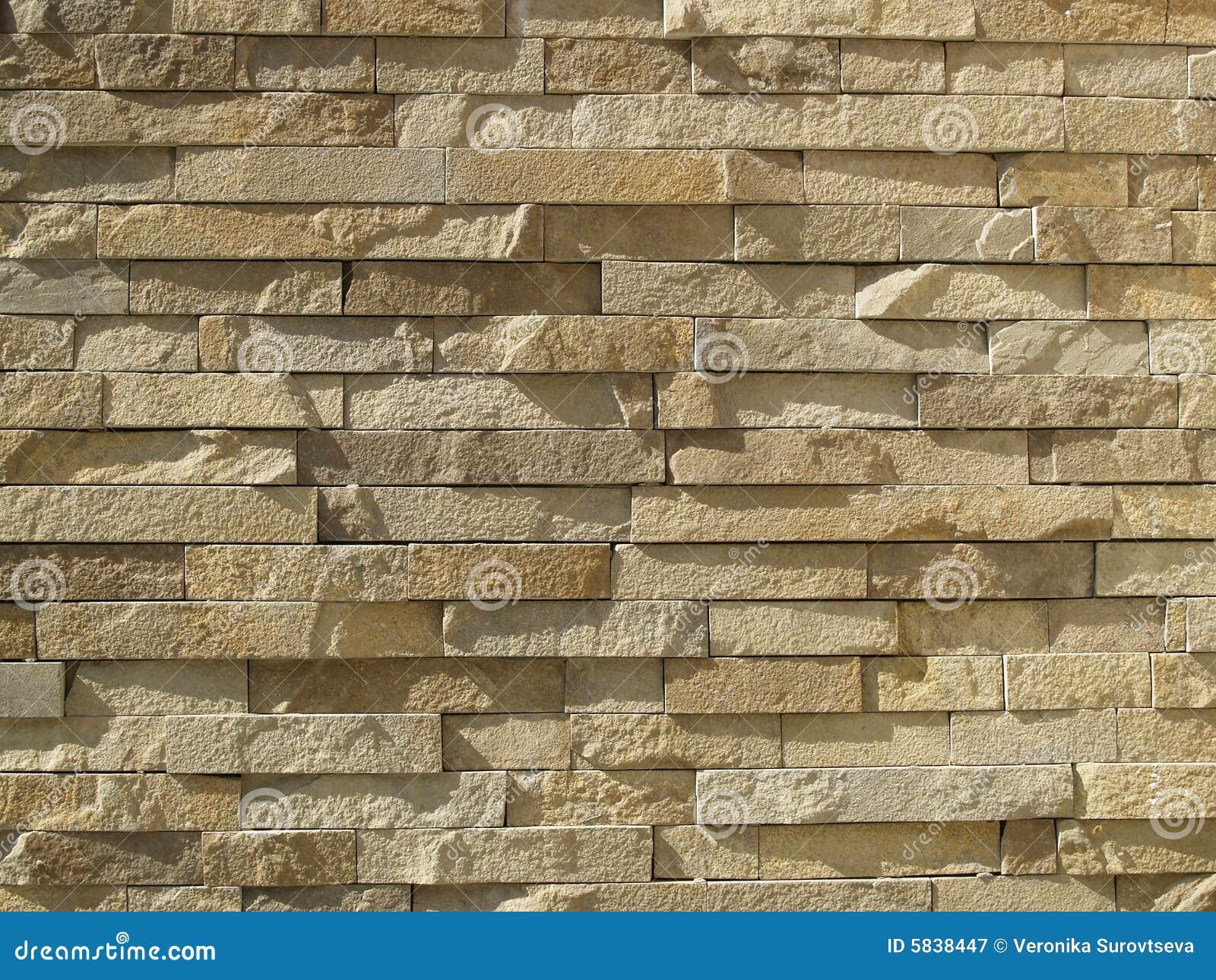 Pared de ladrillos ocres imagen de archivo imagen de - Ladrillos decorativos para exteriores ...