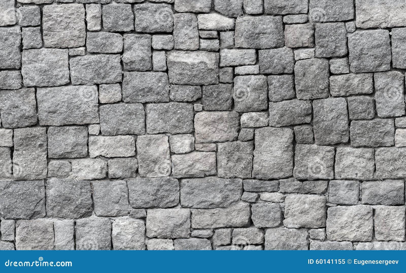 pared de piedra gris vieja textura inconstil del fondo foto de archivo