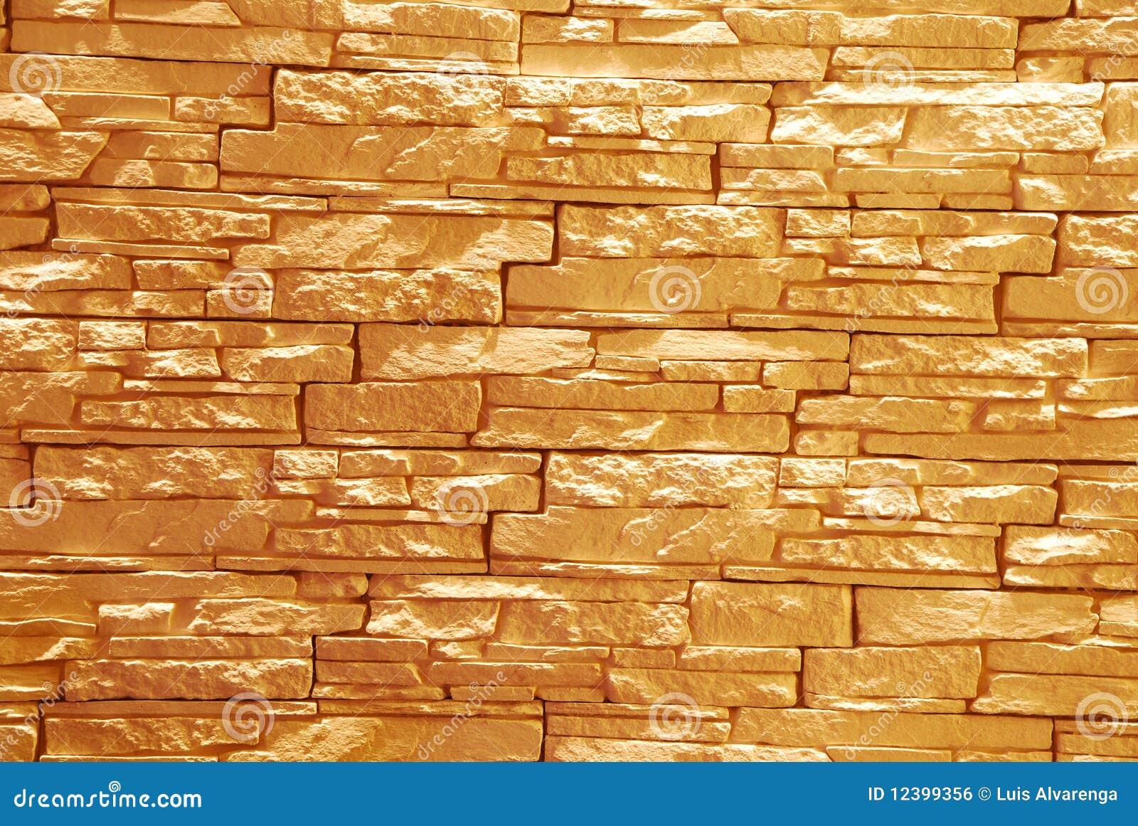 Pared de piedra unshaped iluminada foto de archivo - Pared interior de piedra ...