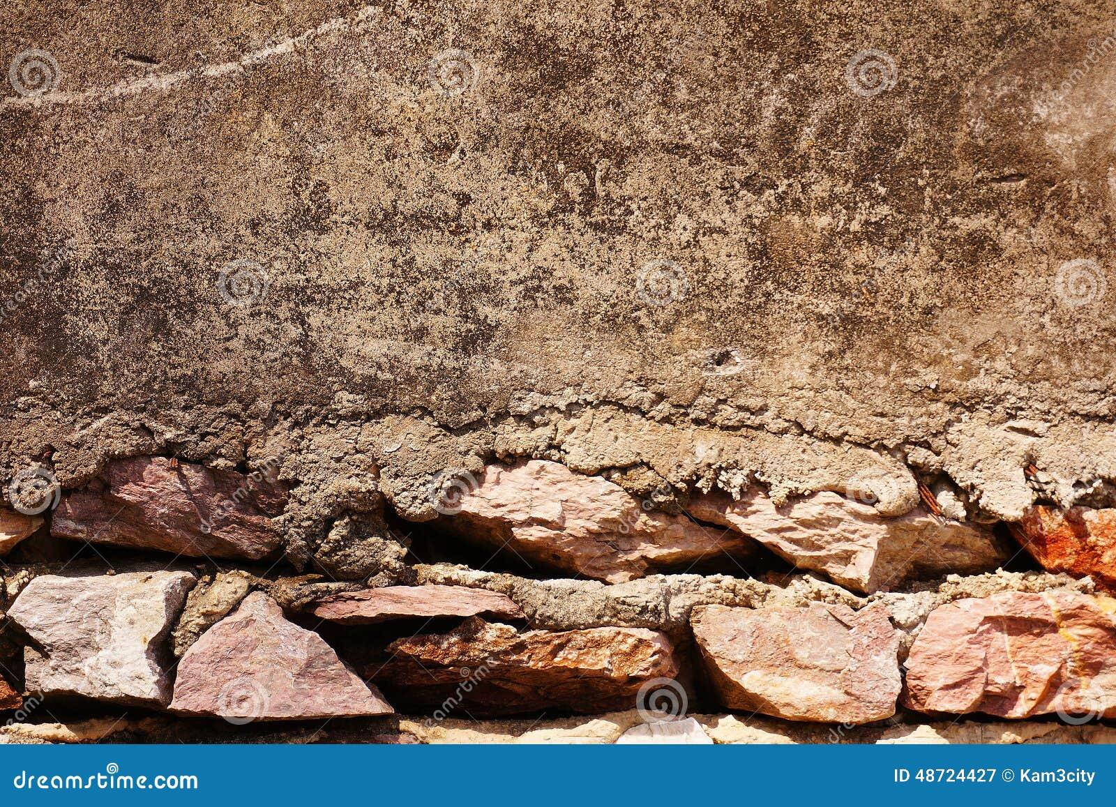 Pared de piedra vieja con el piso del cemento foto de - Paredes de cemento ...