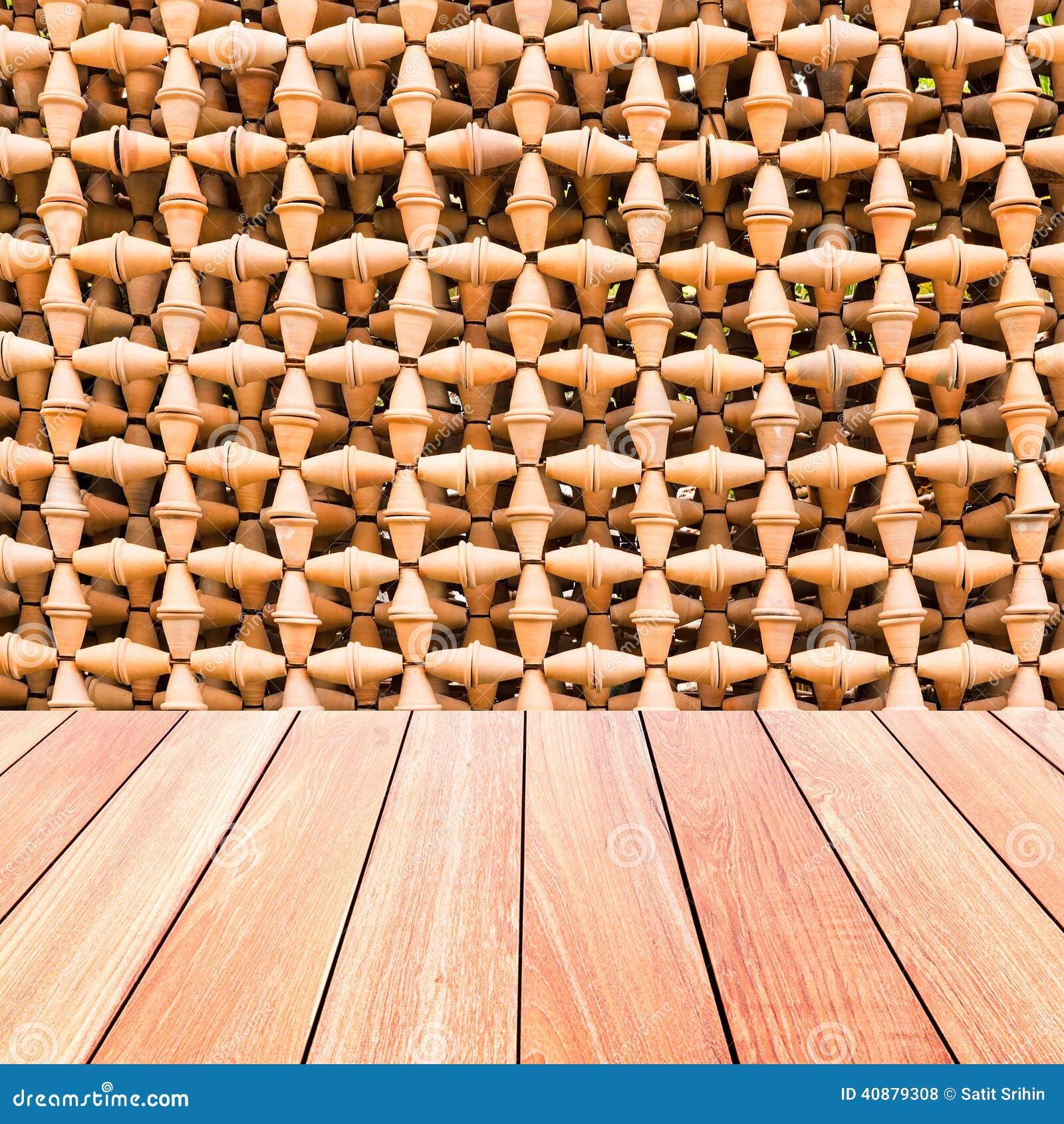 Pared decorativa de los potes de la cer mica con el piso for Ceramica decorativa pared