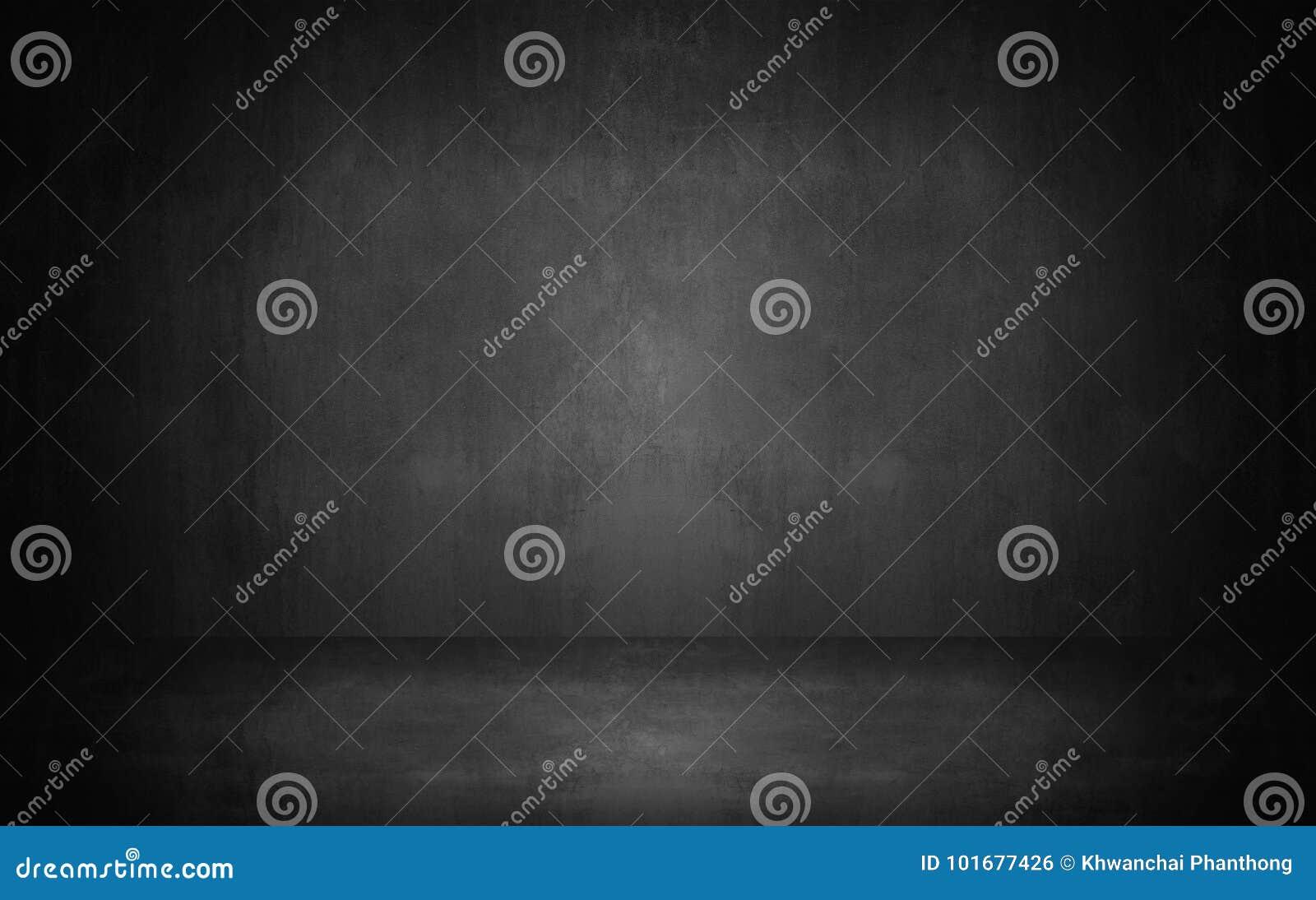 Parede abstrata escura e cinzenta do cimento e CCB do inclinação da sala do estúdio