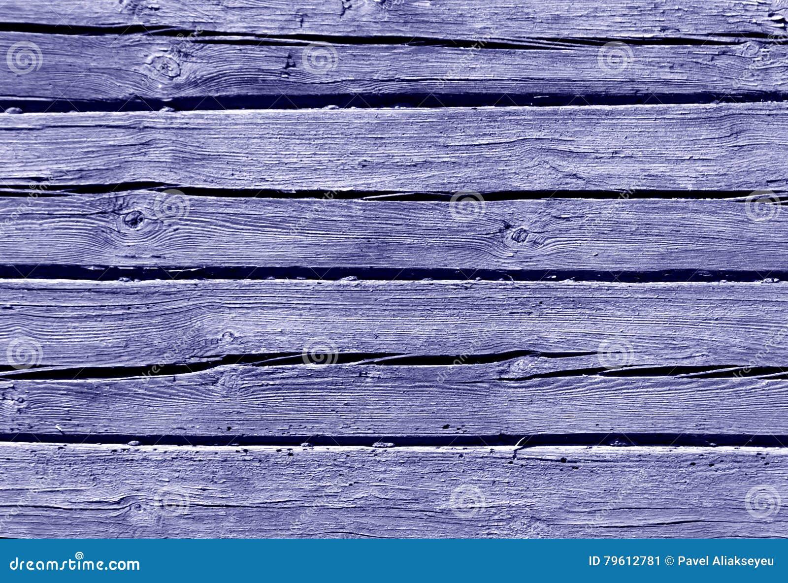 Parede azul da casa de log da cor