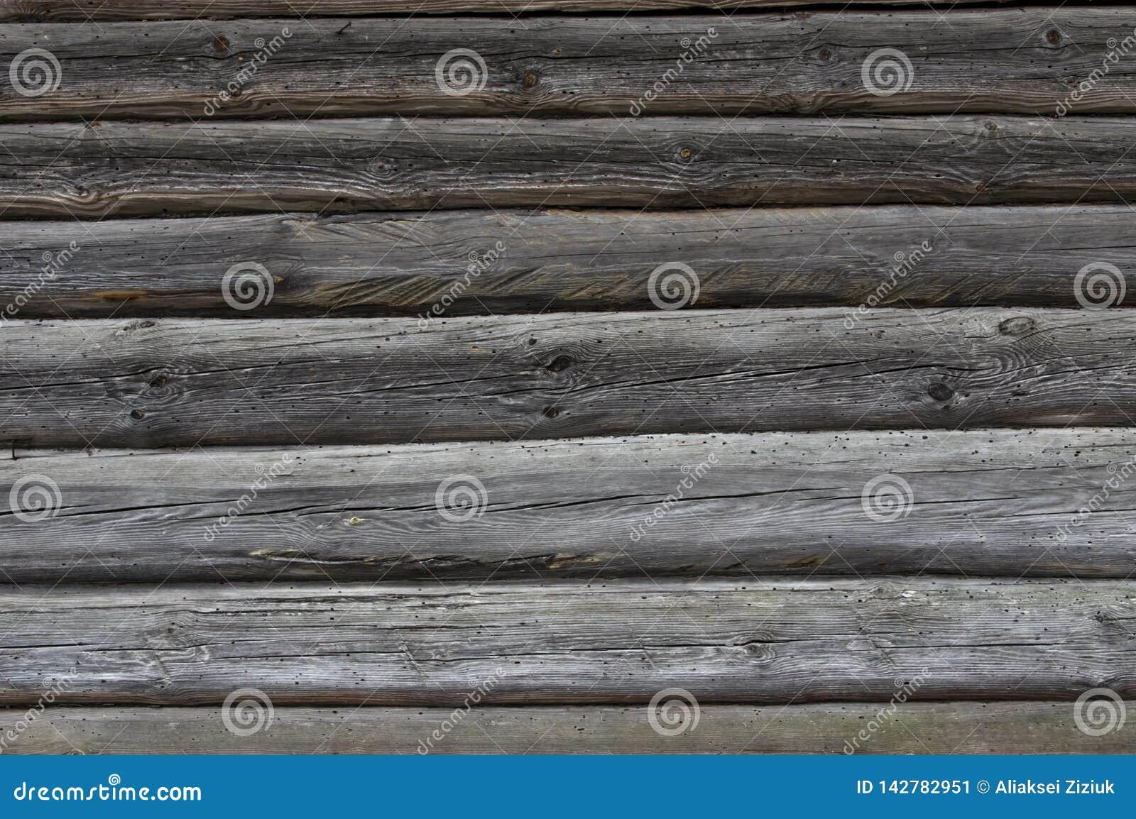 Parede da textura do fundo de uma casa de madeira