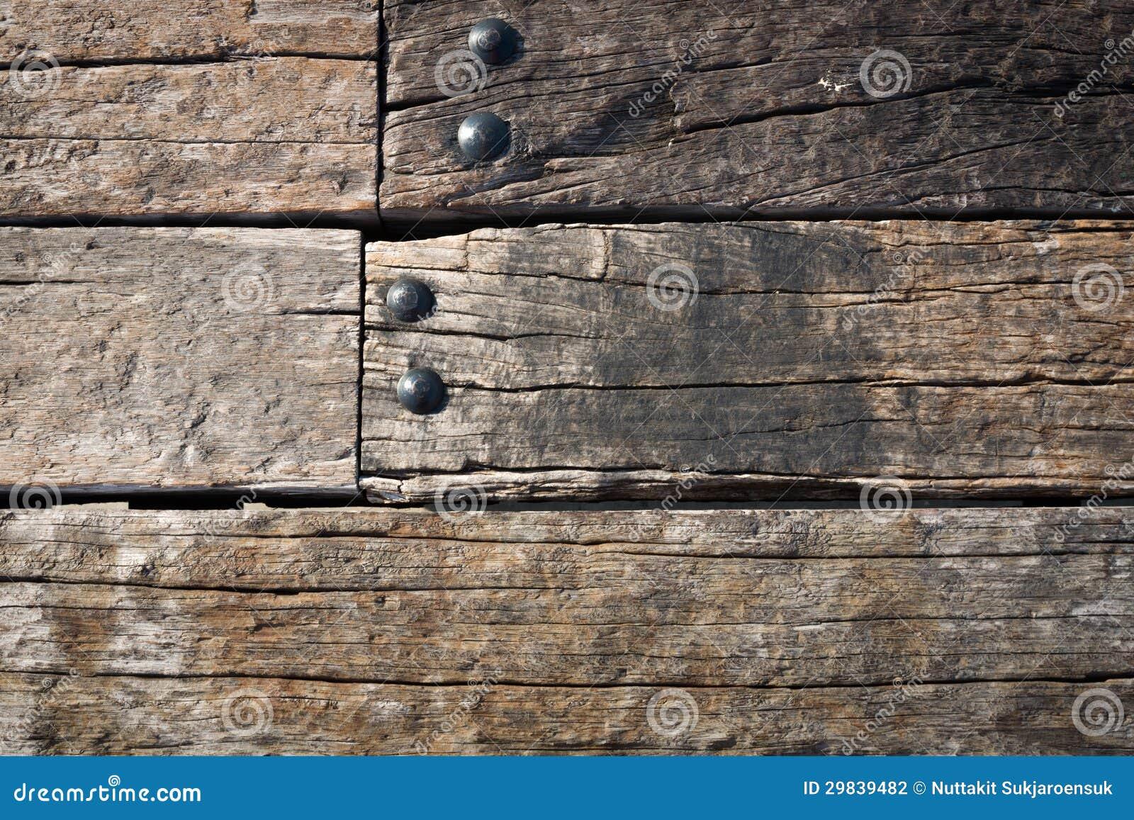 Parede de madeira velha do Grunge e porca redonda do metal