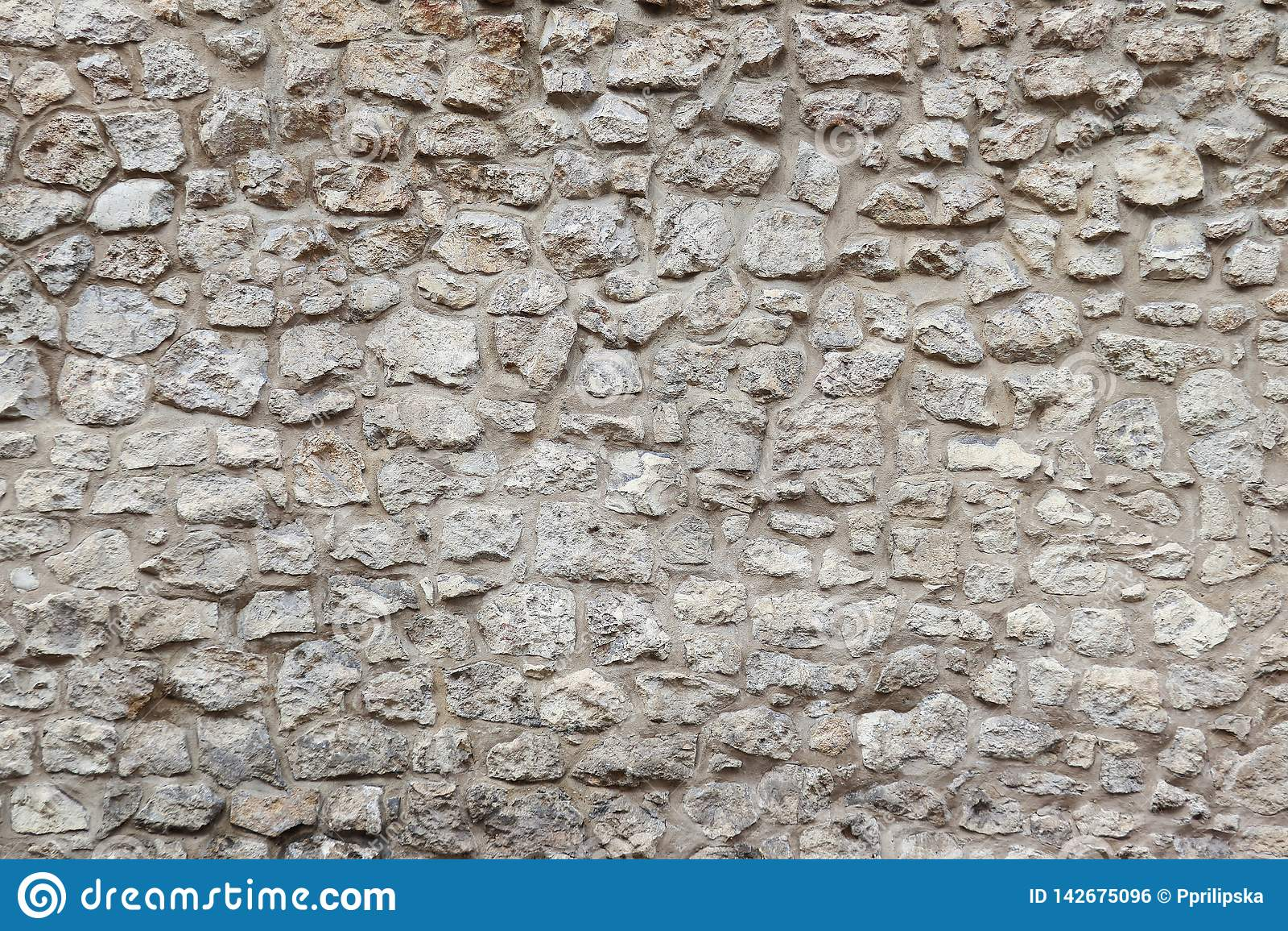 Parede de pedra e cimento velhos Fundo de pedra Parede de pedra de Krakow