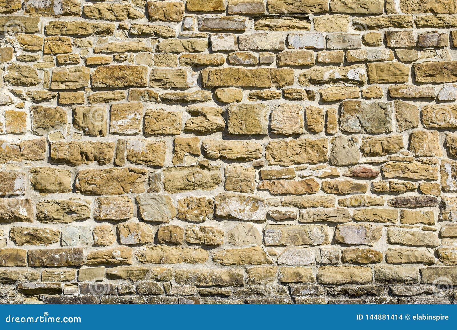 Parede de pedra, fundo, textura ou teste padr?o natural velho Textura r?stica Parede com os tijolos de pedras italianas