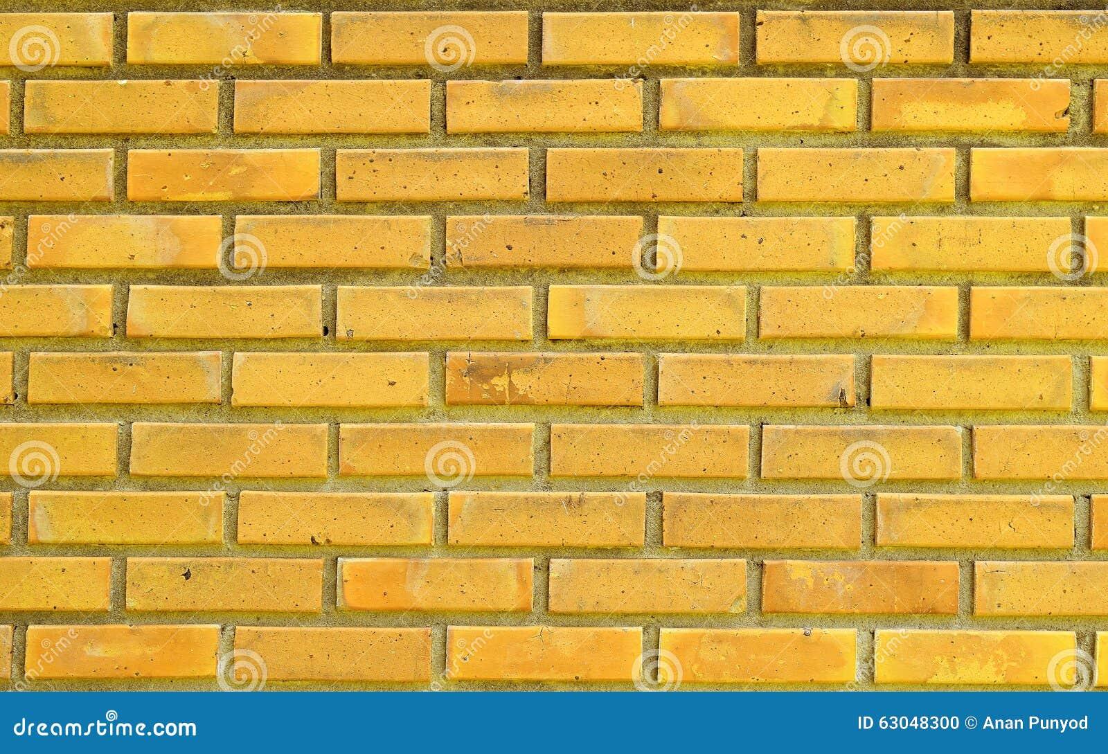 Parede de tijolo amarela para o fundo das texturas