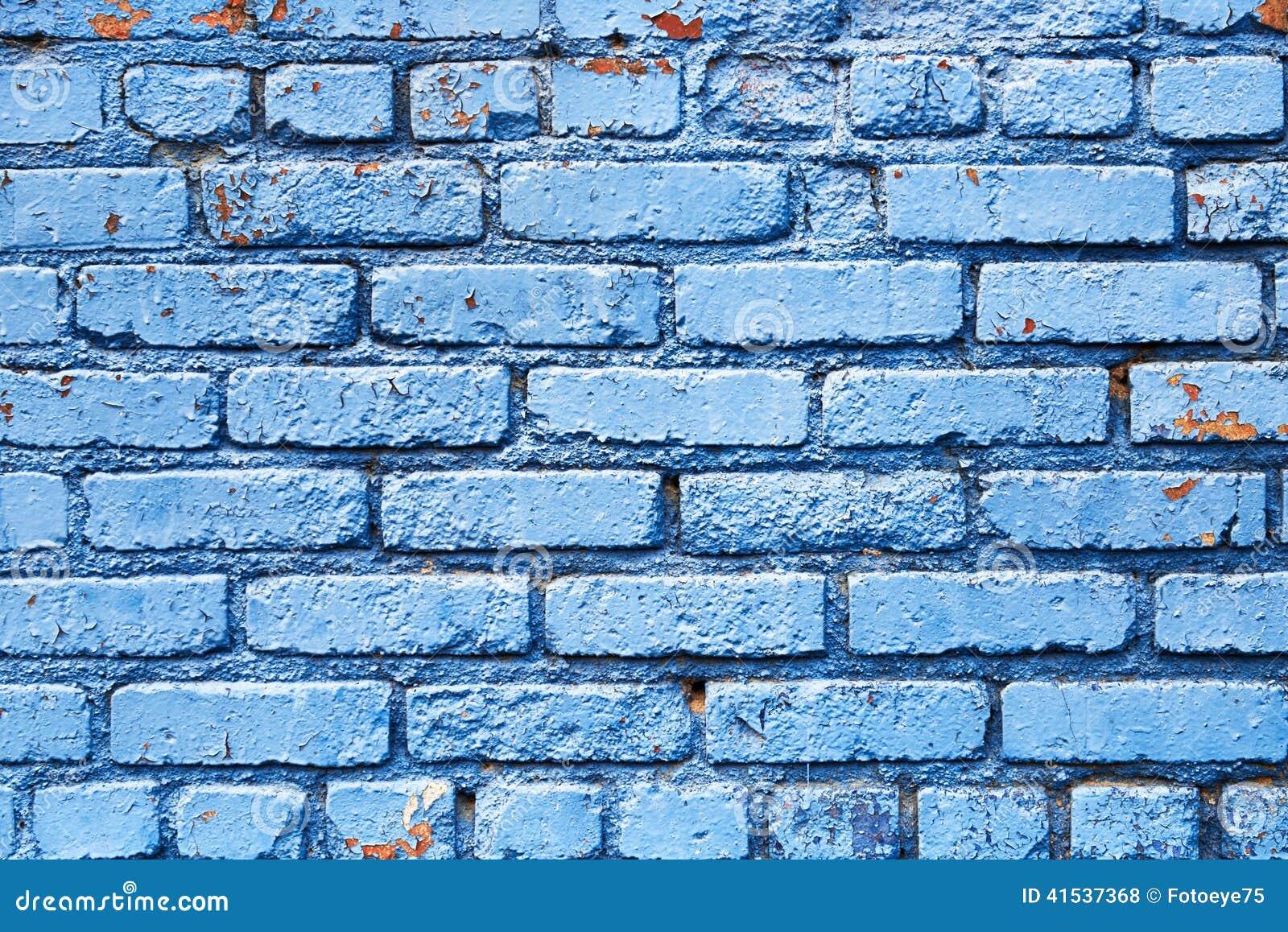 Parede de tijolo azul com textura do fundo da pintura da casca