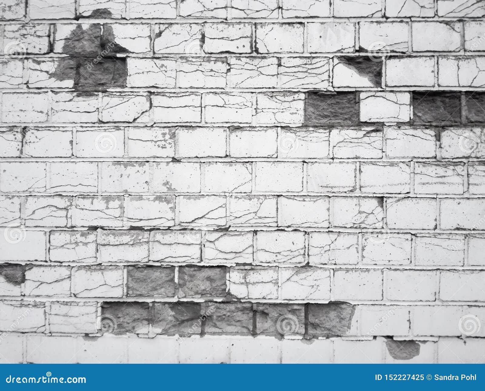 Parede de tijolo quebrada preto e branco