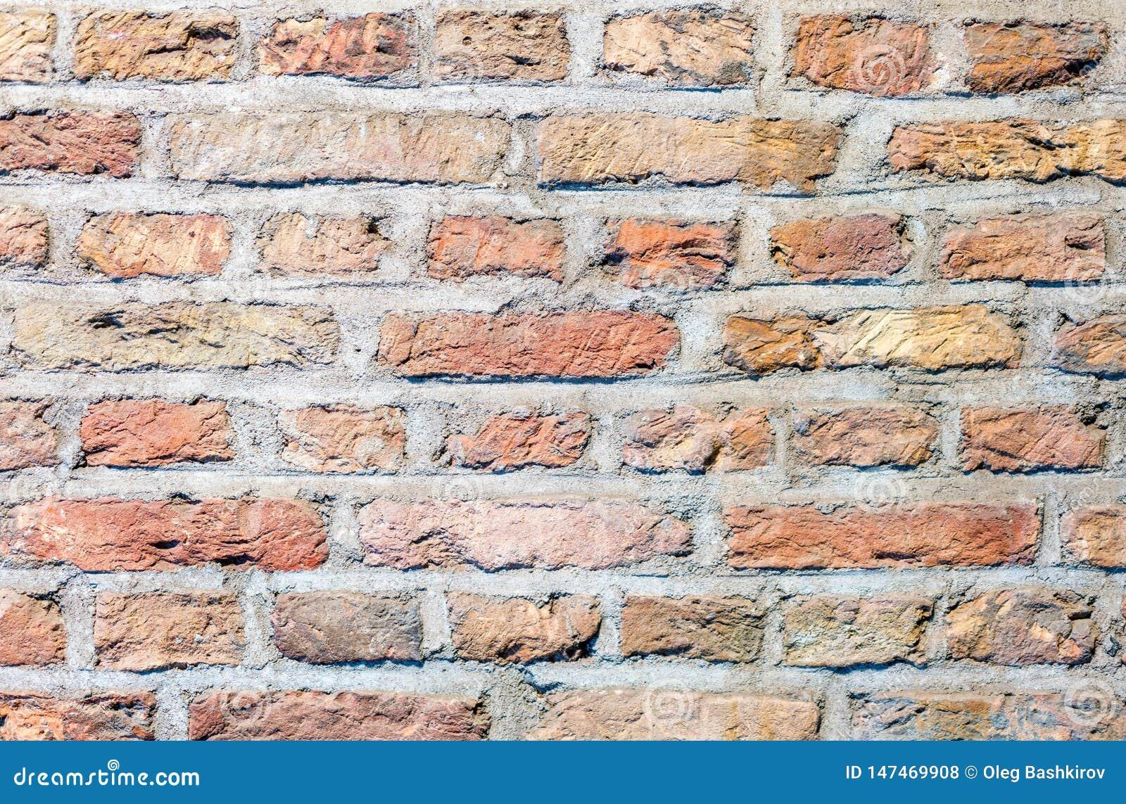Parede de tijolo, teste padrão do papel de parede, textura do fundo