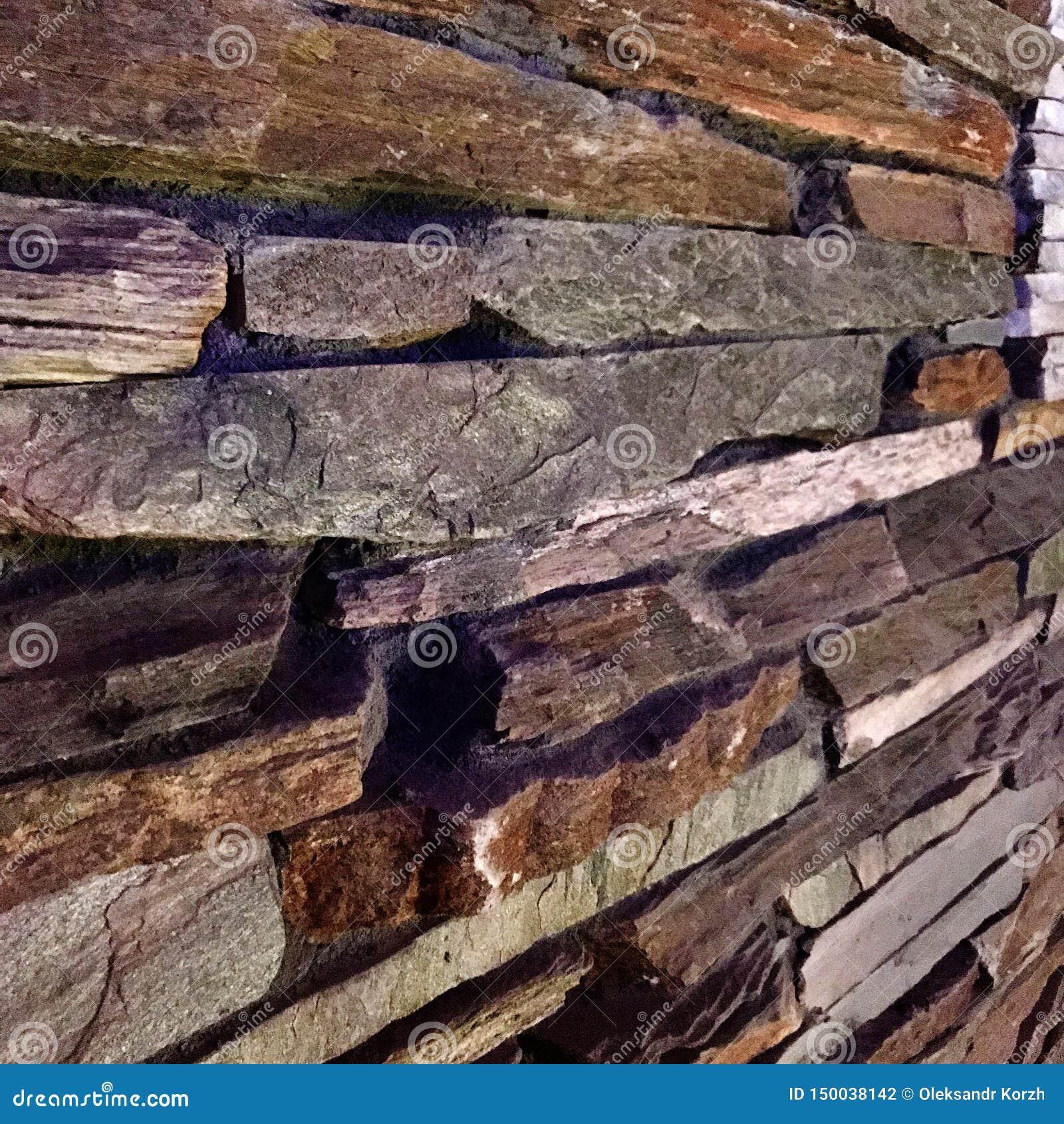 Parede de tijolo textured velha de pedras à moda para a decoração da casa
