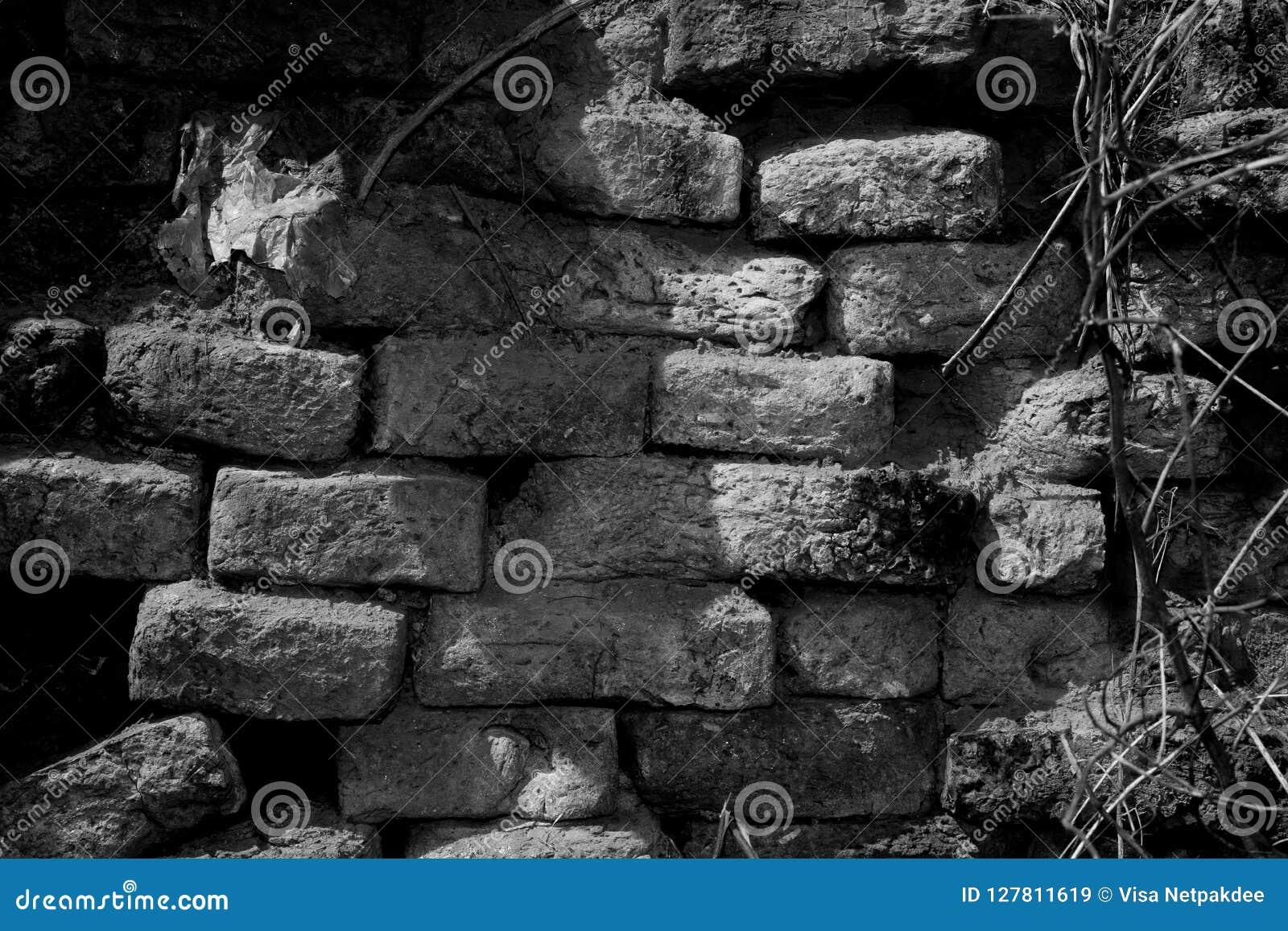 Parede de tijolo velha preto e branco para a textura
