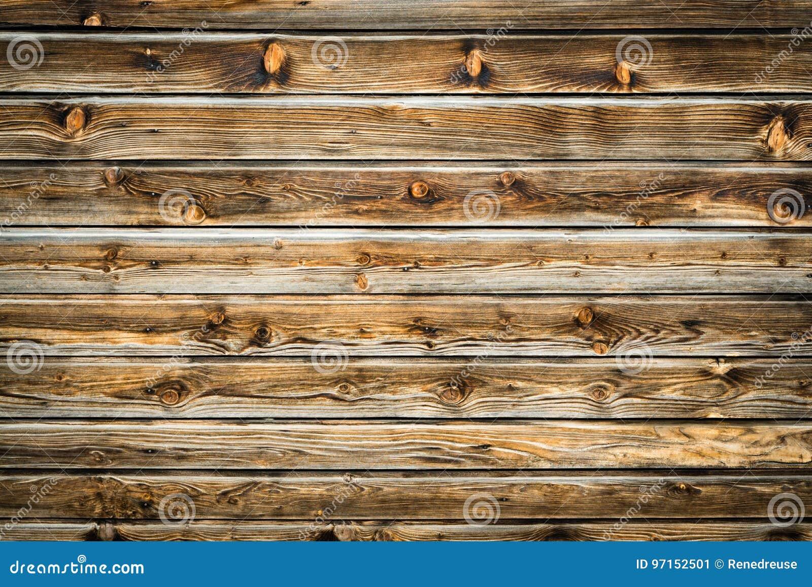 Parede marrom natural da madeira do celeiro Teste padrão textured de madeira do fundo