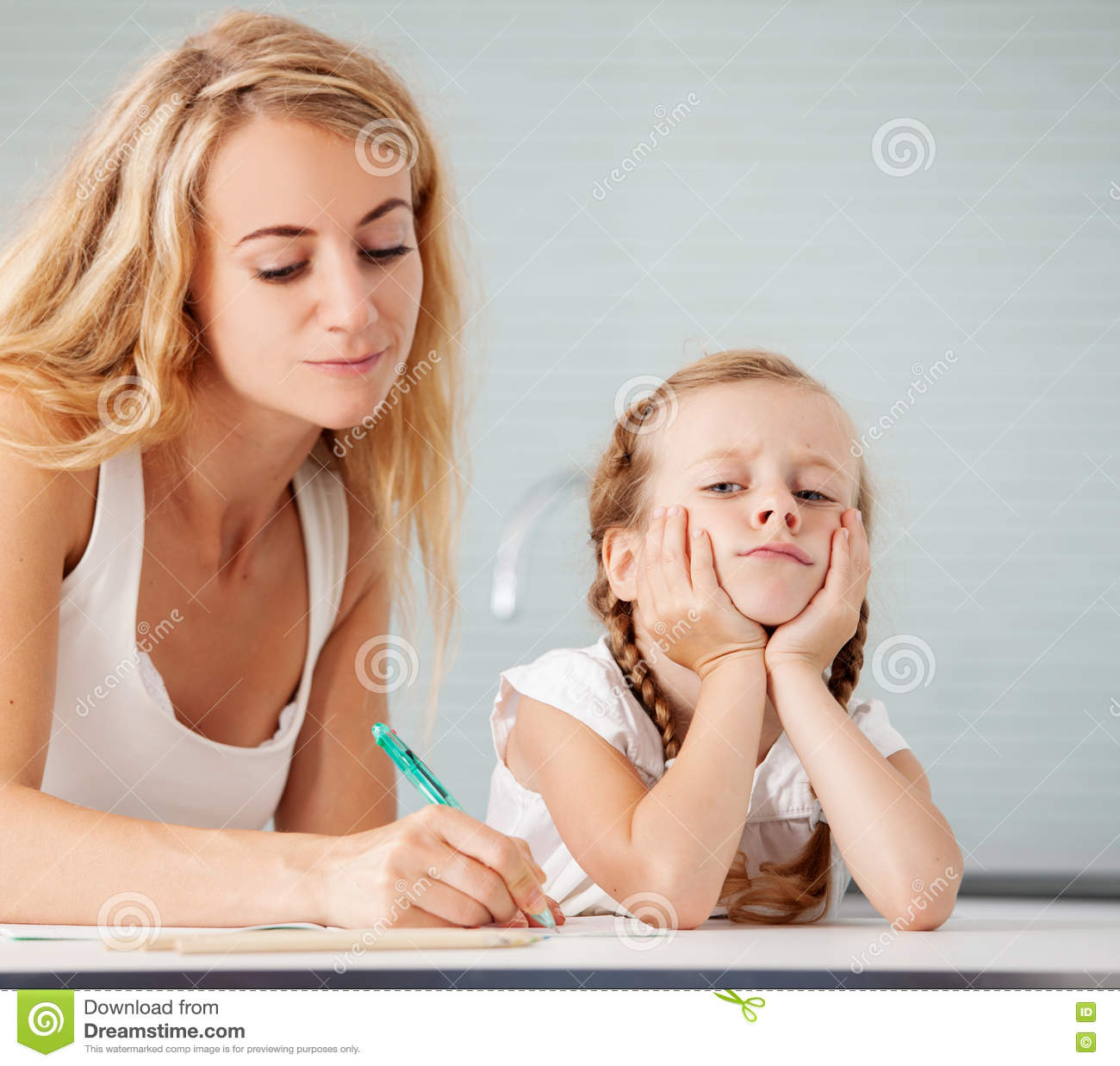 Parent Helps The Child To Do Homework Stock Photo - Image: 72163262
