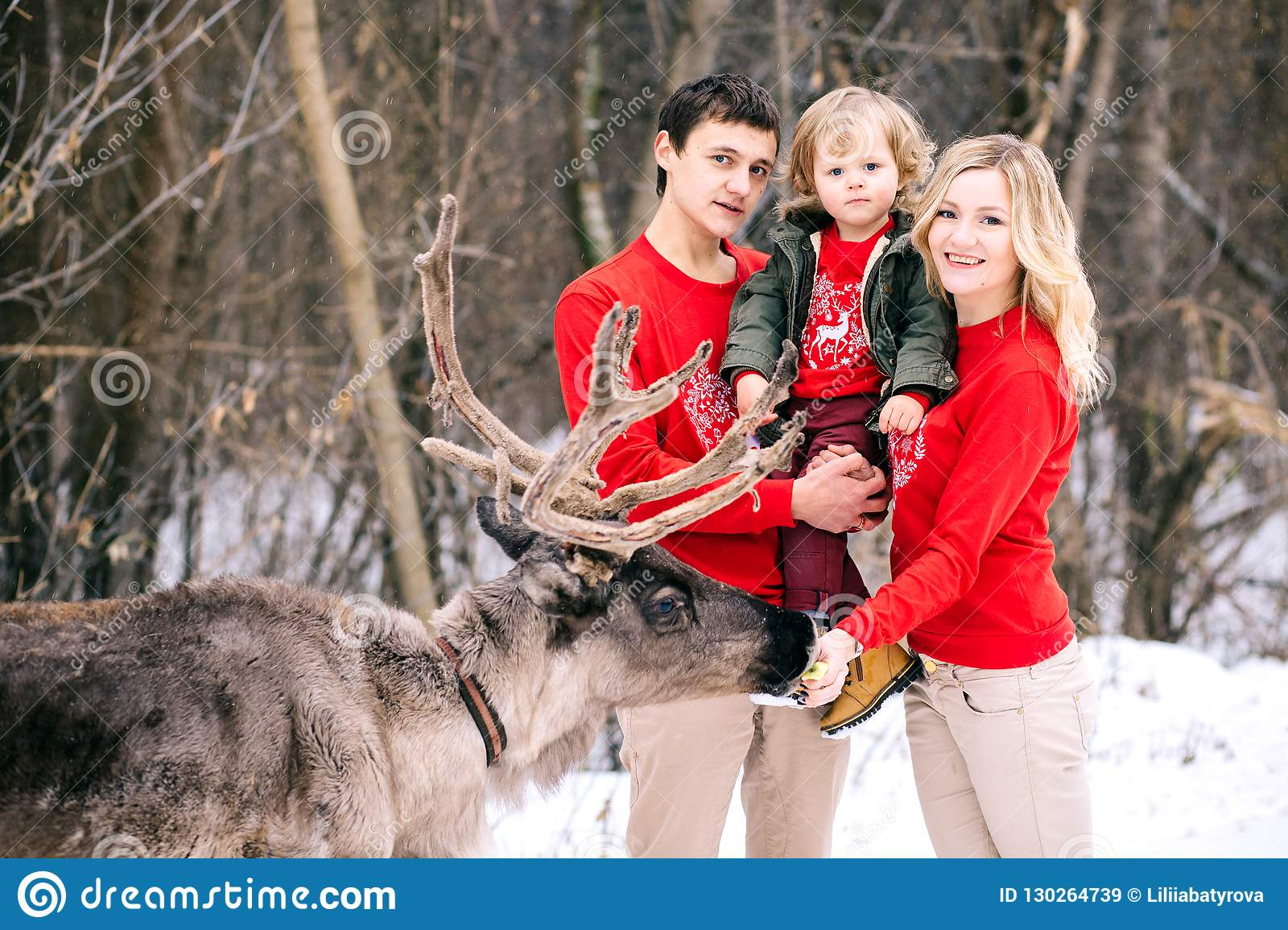 Parenthood Fashion Season And People Concept Happy Family With Child In Winter Clothes Outdoors Stock Image Image Of Face Embracing 130264739