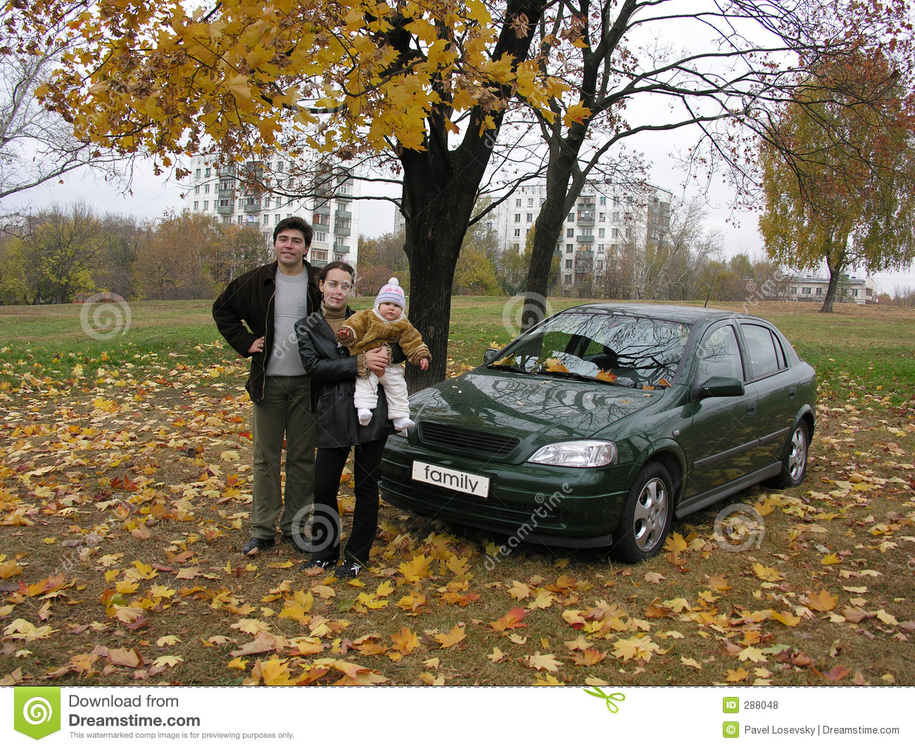 Parents with baby and car and autumn