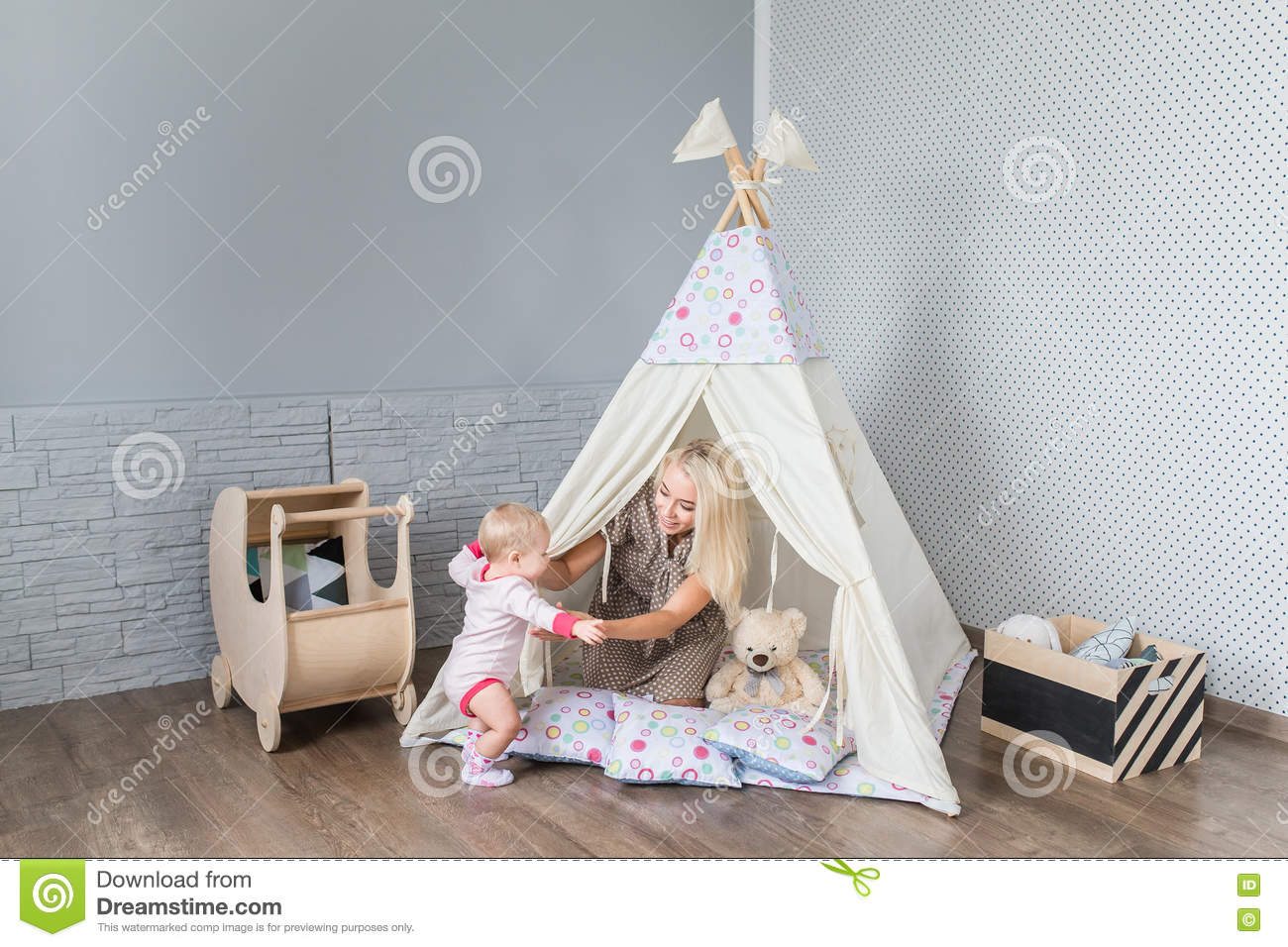 Parents with children in a teepee