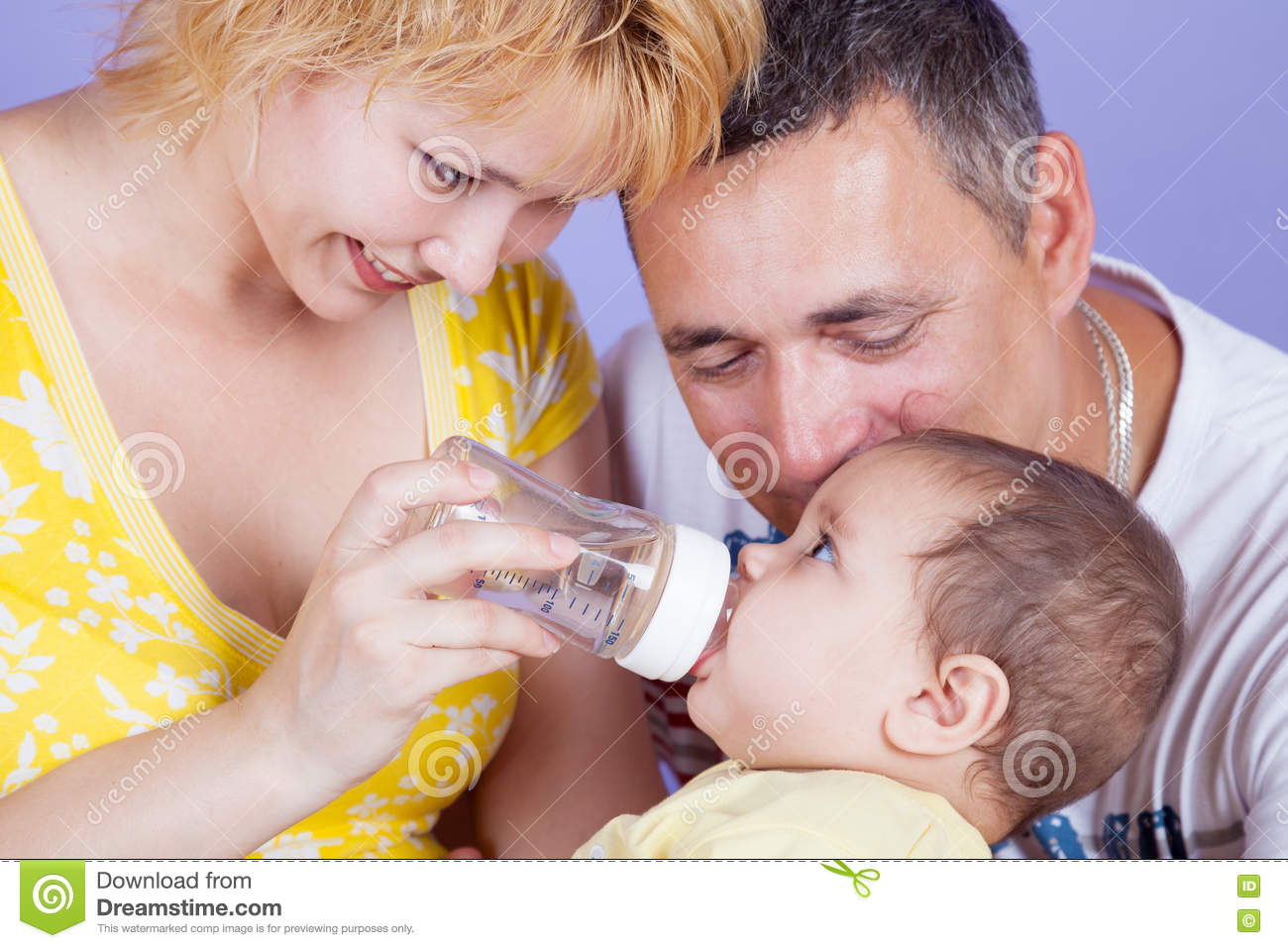 Parents fed by baby bottle