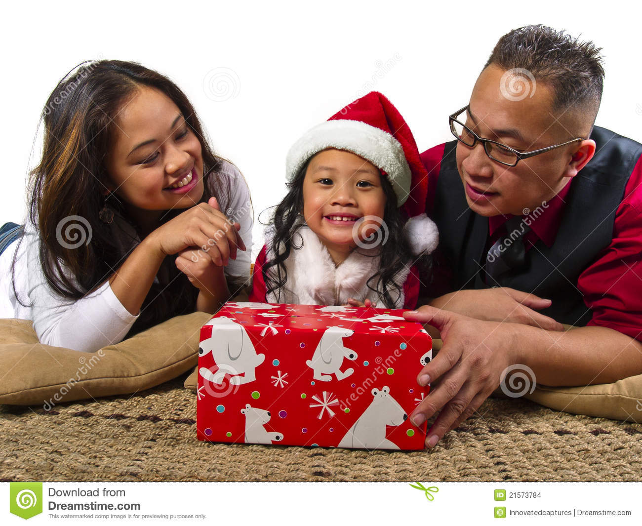 Parents Giving The Child A Christmas Gift Stock Photo ...