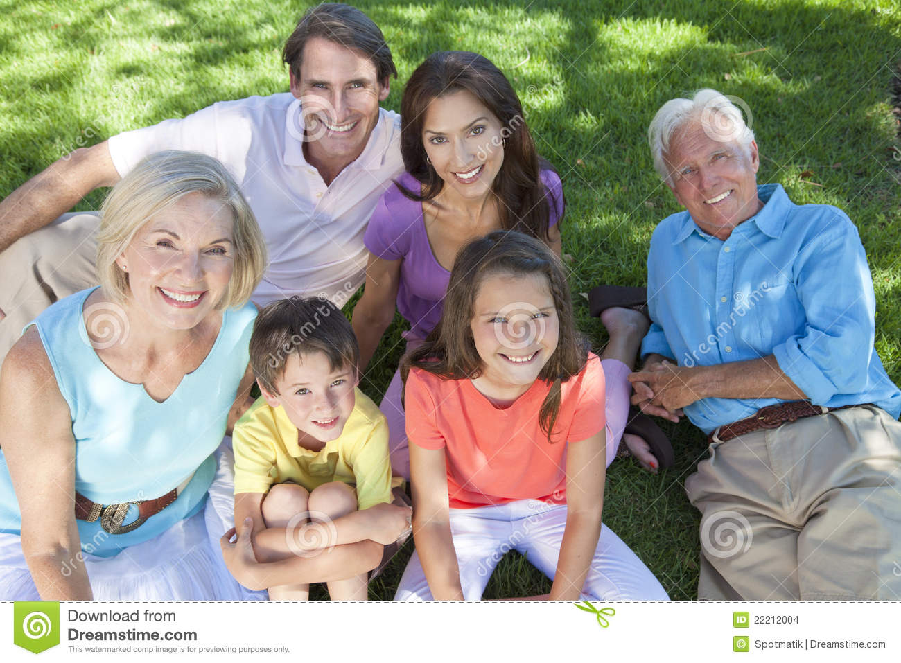 parents grandparents children family relaxing stock photo