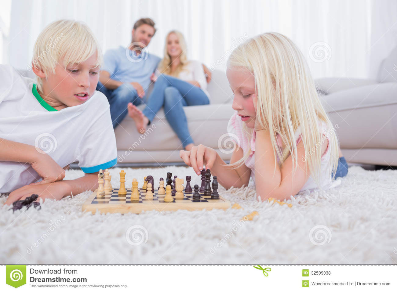 Parents Looking At Their Children Playing Chess Royalty