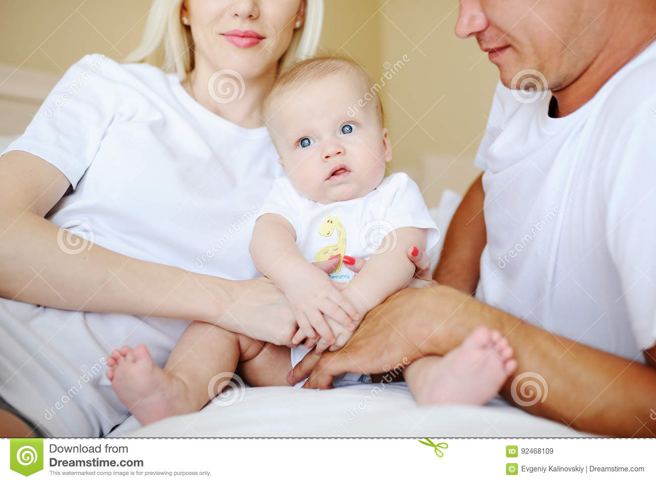 Baby Bed With Parents - Parents playing with baby in bed stock photo