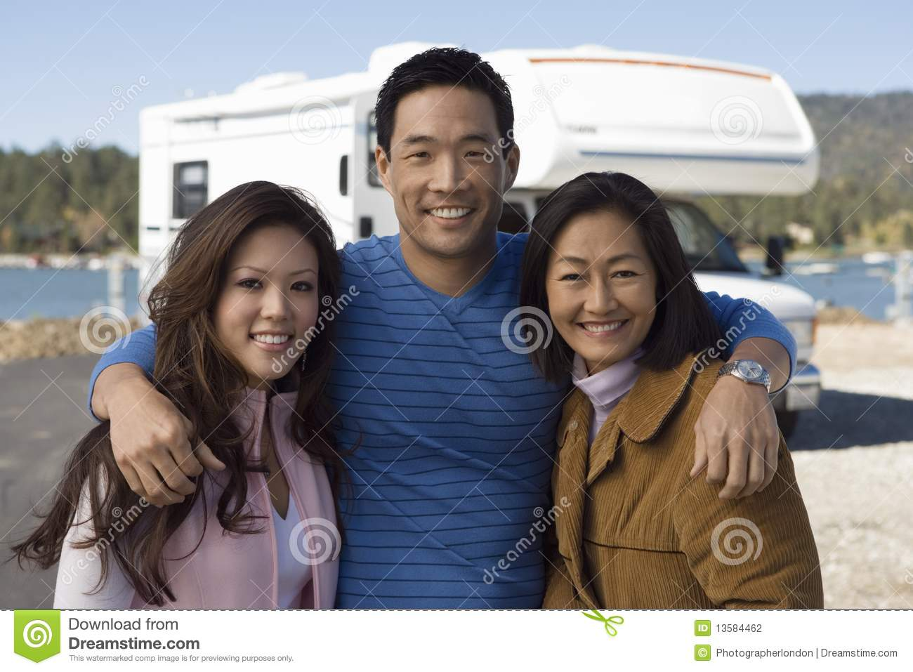 Parents and teenage daughter outside of RV