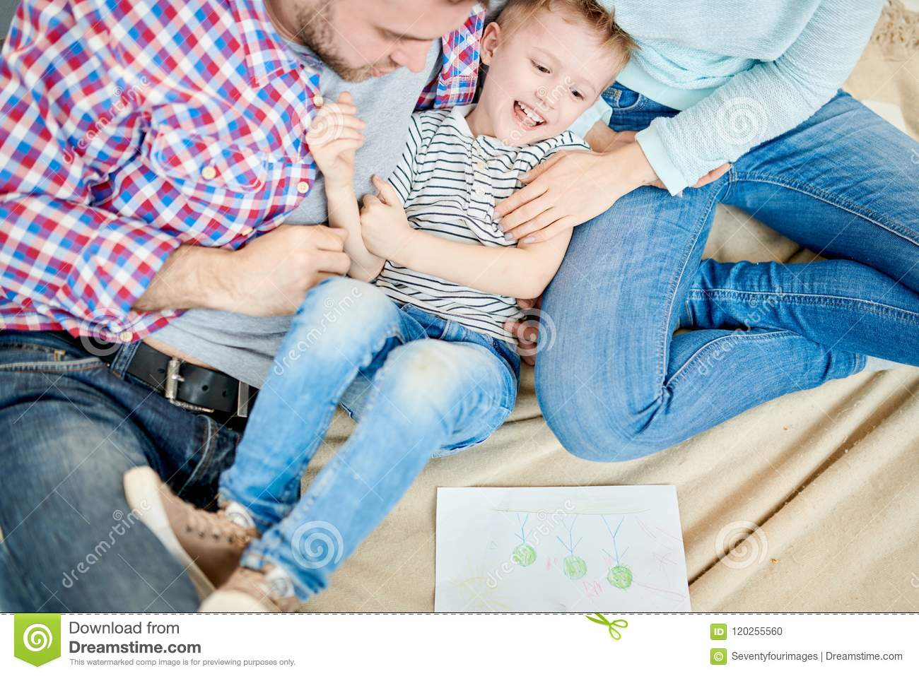 Parents Tickling Cute Little Boy