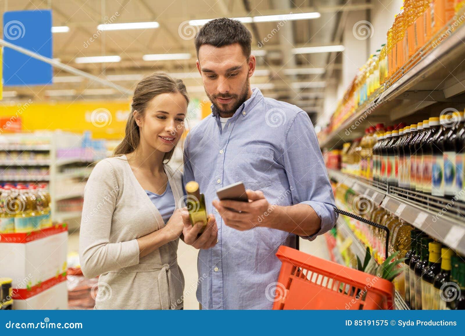 Pares com azeite de compra do smartphone no mantimento