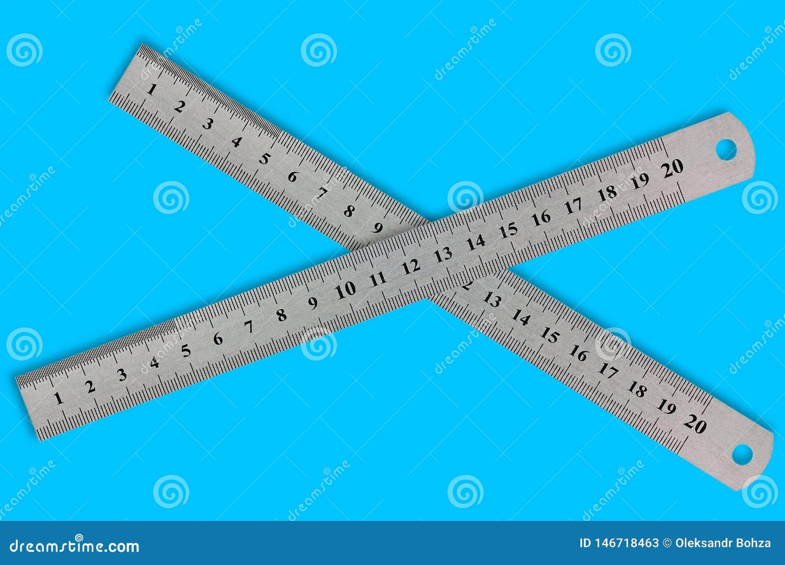 Pares de réguas de precisão do metal com dígitos e escala