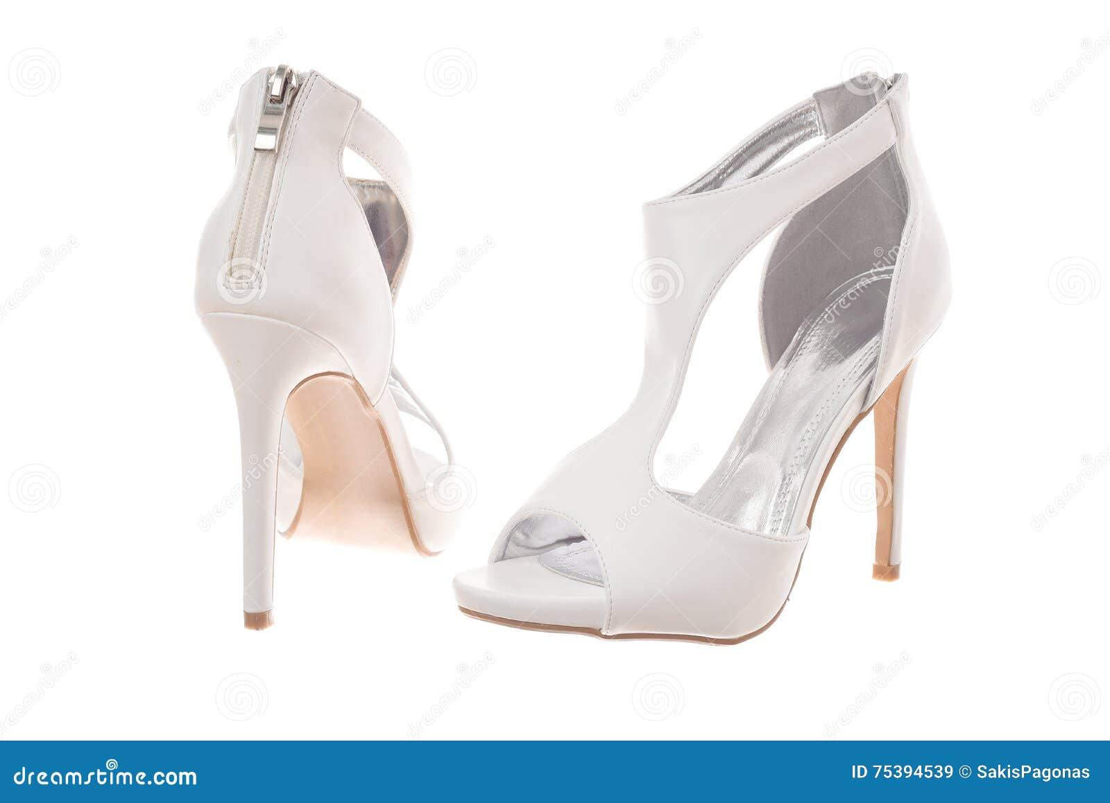 e97d4a0ec716 Pares De Zapatos Blancos De La Mujer Del Tacón Alto Imagen de ...