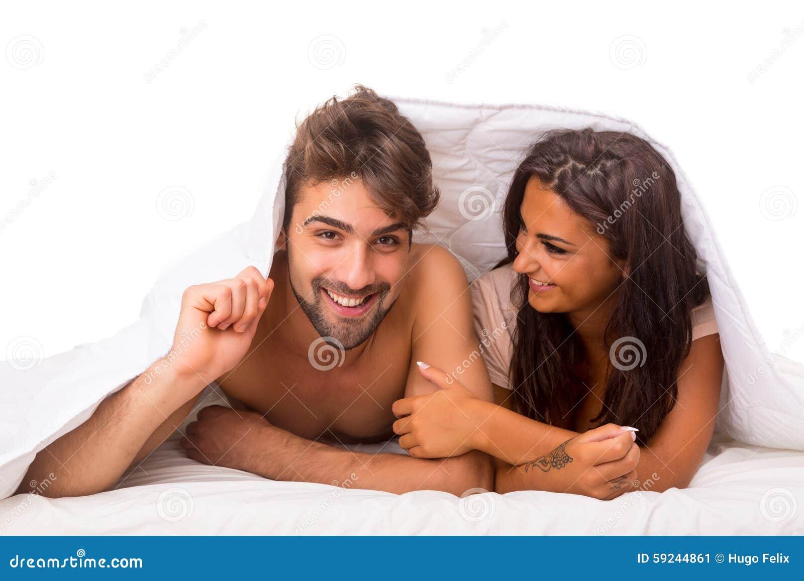 Download Pares en cama imagen de archivo. Imagen de belleza, hembra - 59244861