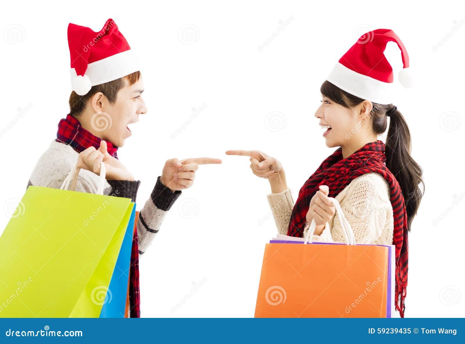 Download Pares Jovenes Con Los Panieres Para El Día De Fiesta De La Navidad Imagen de archivo - Imagen de holding, gesto: 59239435