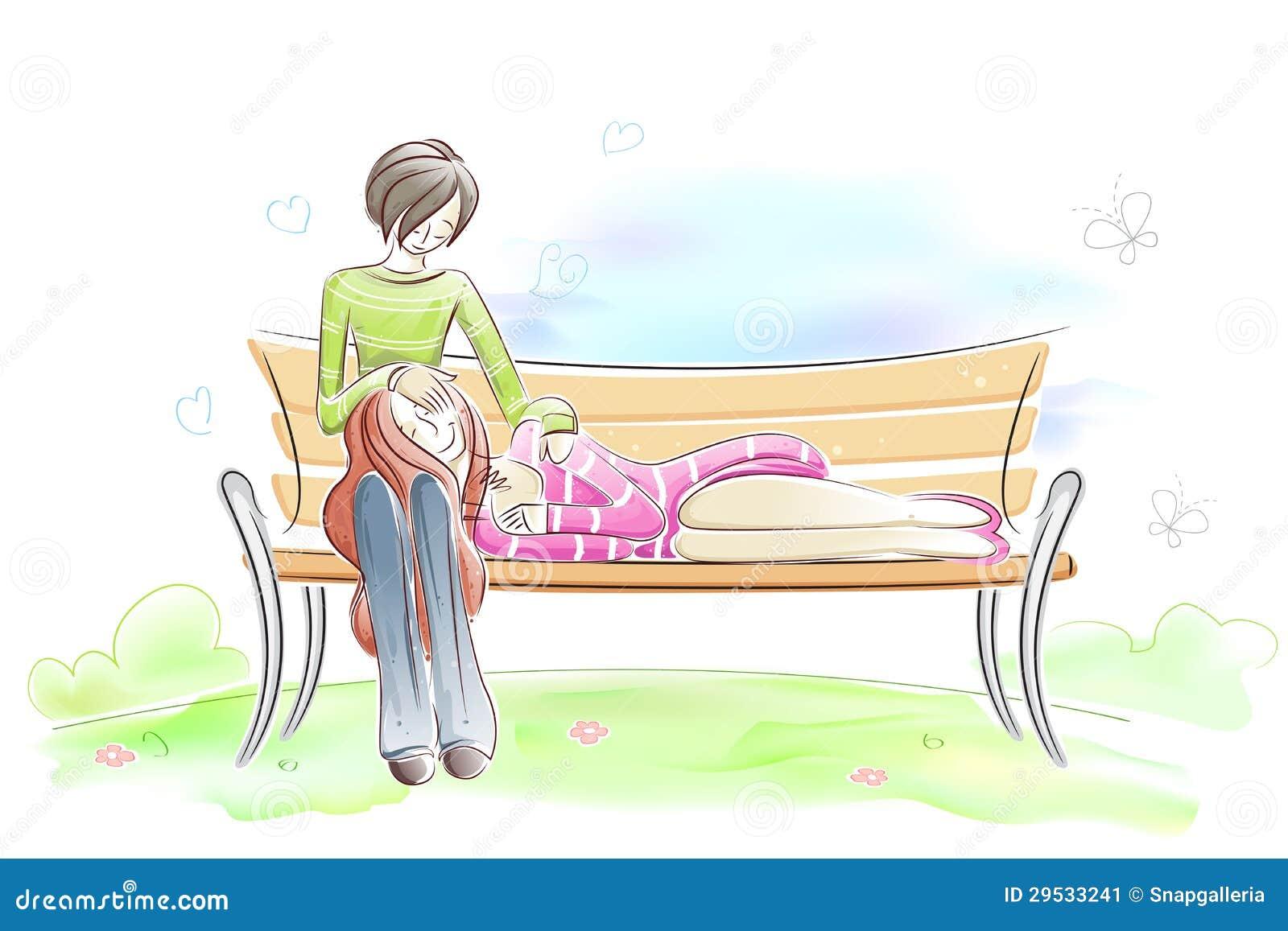 Pares que sentam-se no banco de parque