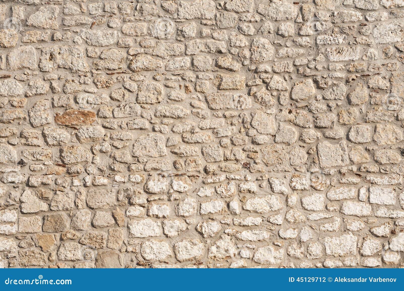 Parete della casa della muratura di pietra fotografia - Parete di pietra ...