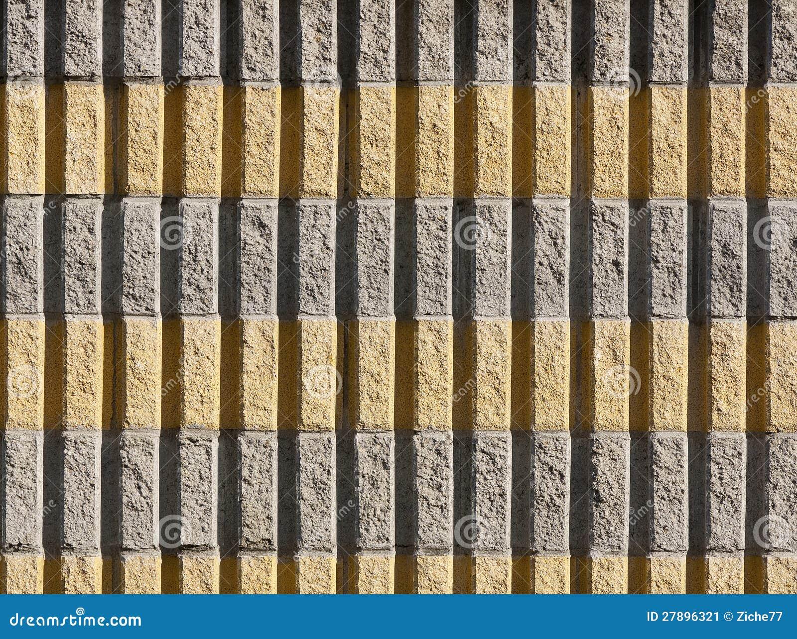 Parete Gialla E Verde : Parete di mattoni gialla e grigia immagine stock
