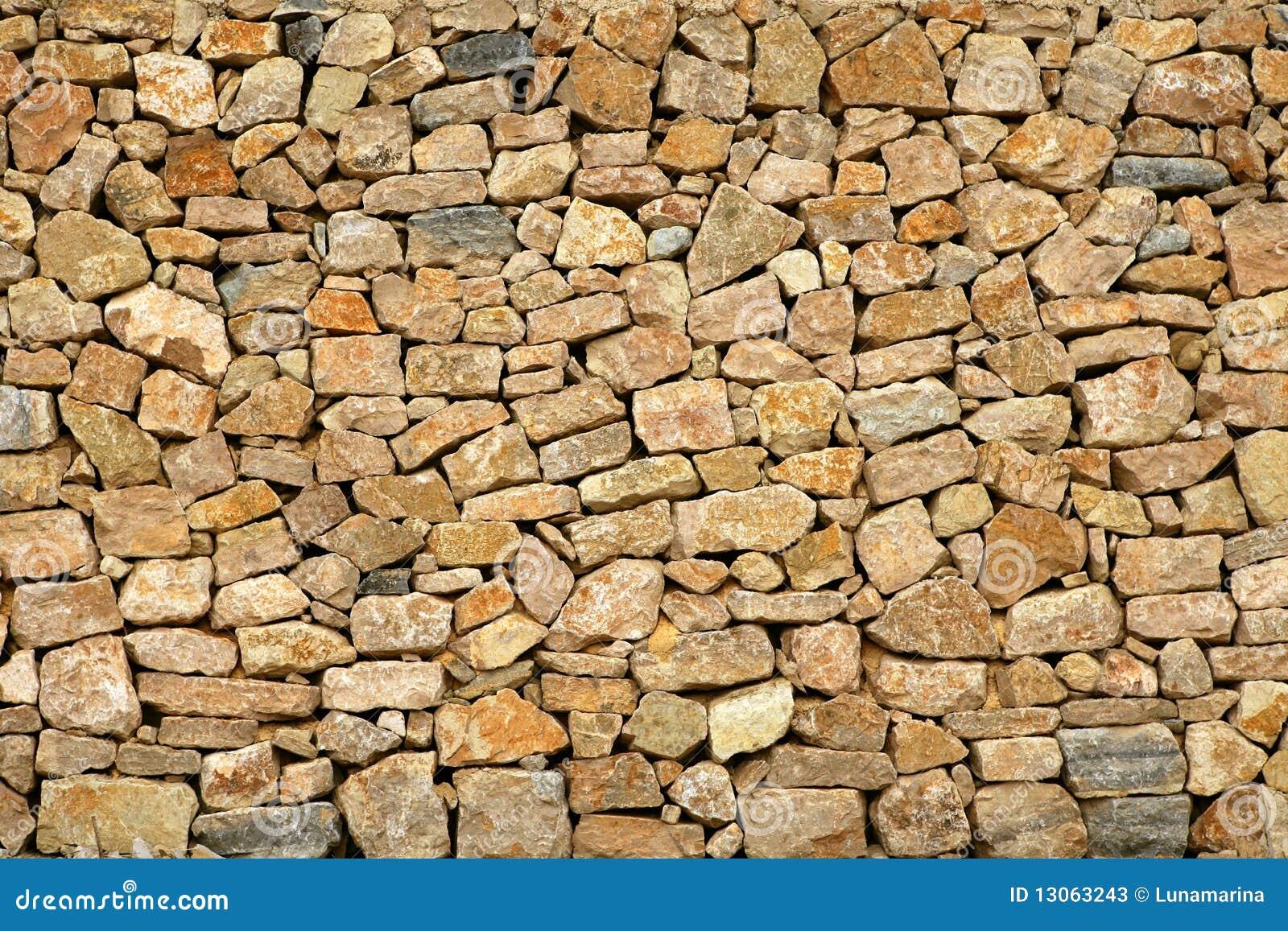 Parete di pietra della massoneria dorata da vecchia - Parete di pietra ...