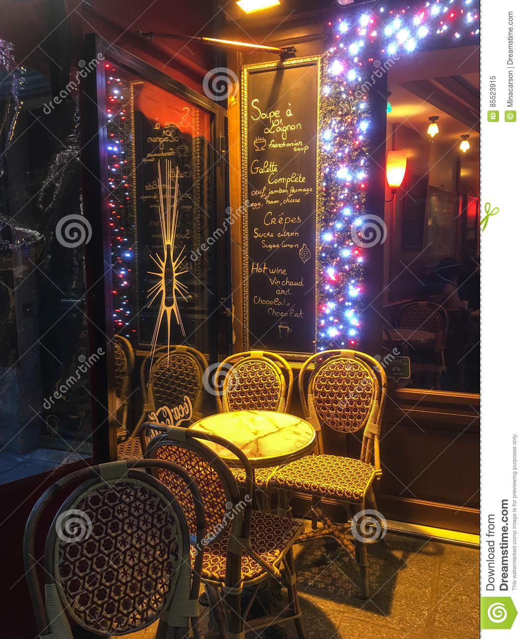 Paris Cafe Table On A Winter Night With Menu Chalked On A Board