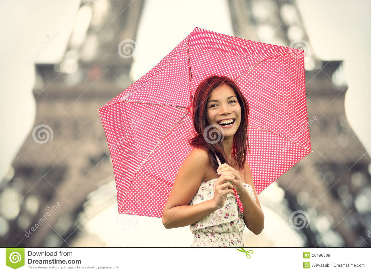 Eiffel tower woman happy smiling in front of tourist attraction eiffel
